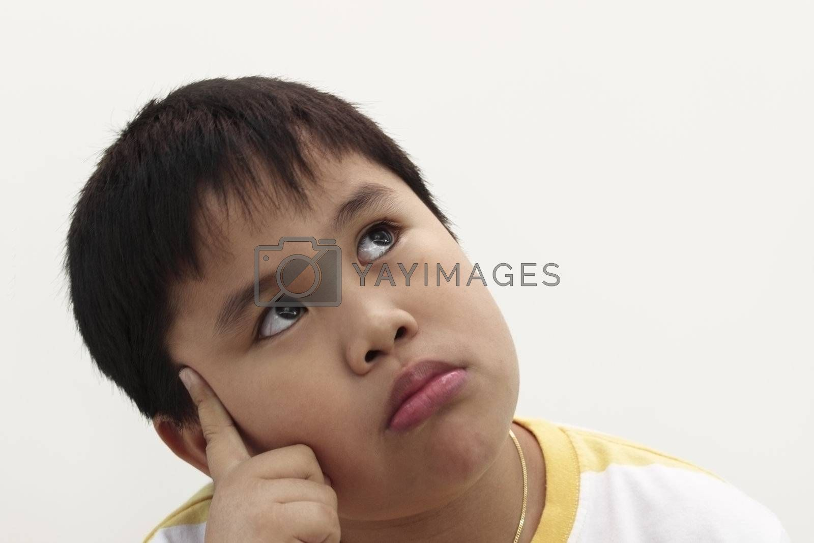 Nine  years old boy in white background