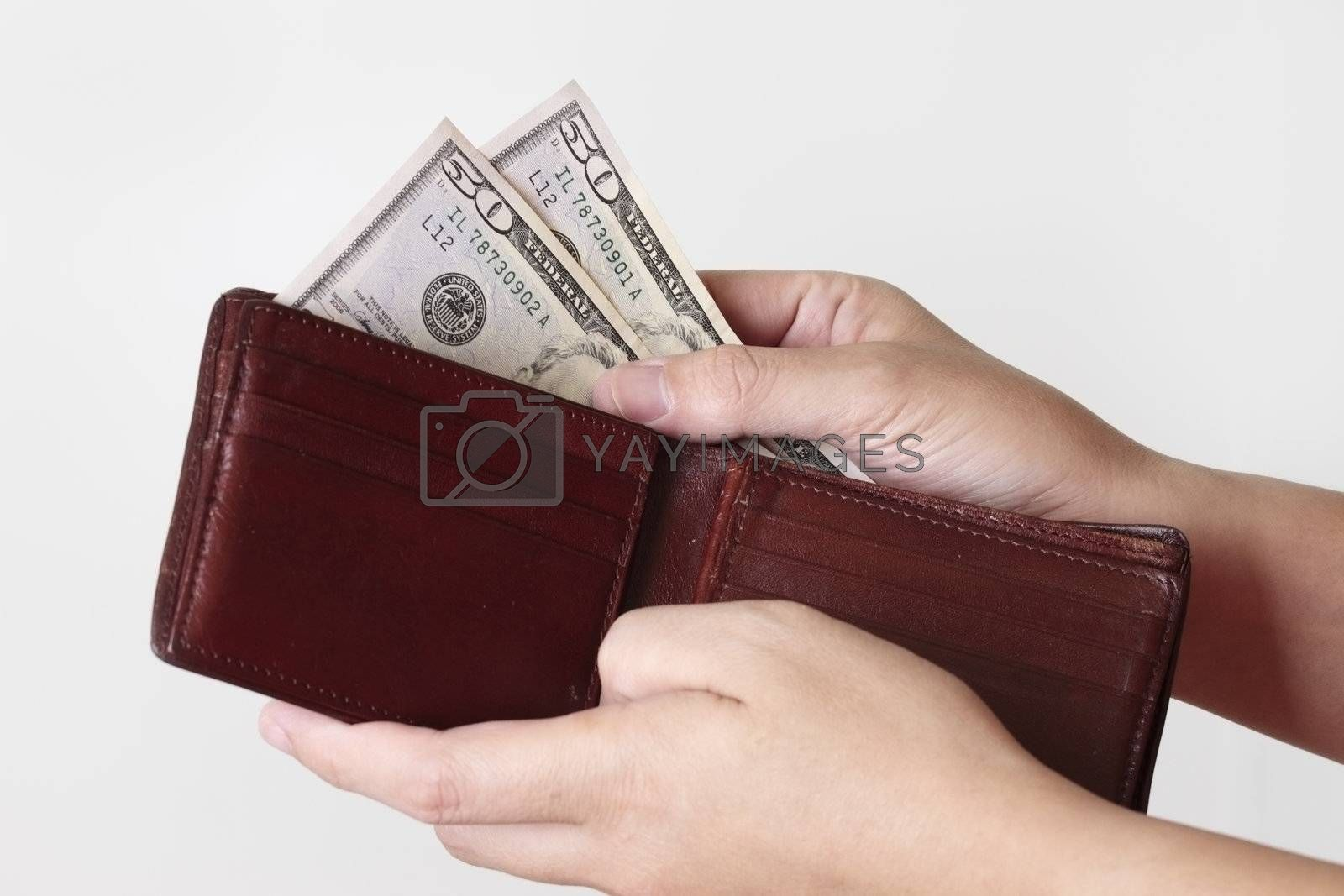 Fifty dollars in purse isolated on white background