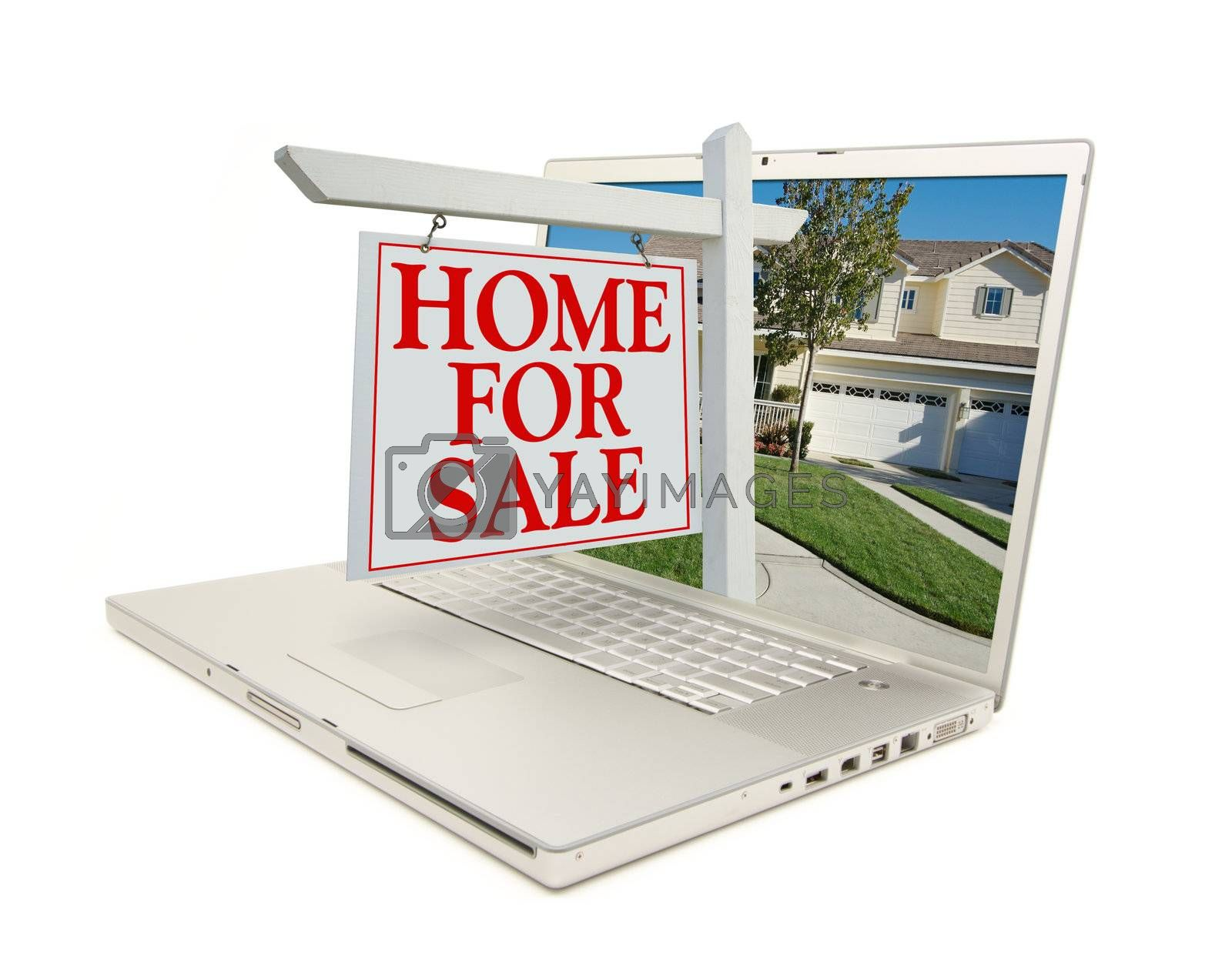 Home for Sale Sign & New Home on Laptop isolated on a white Background.