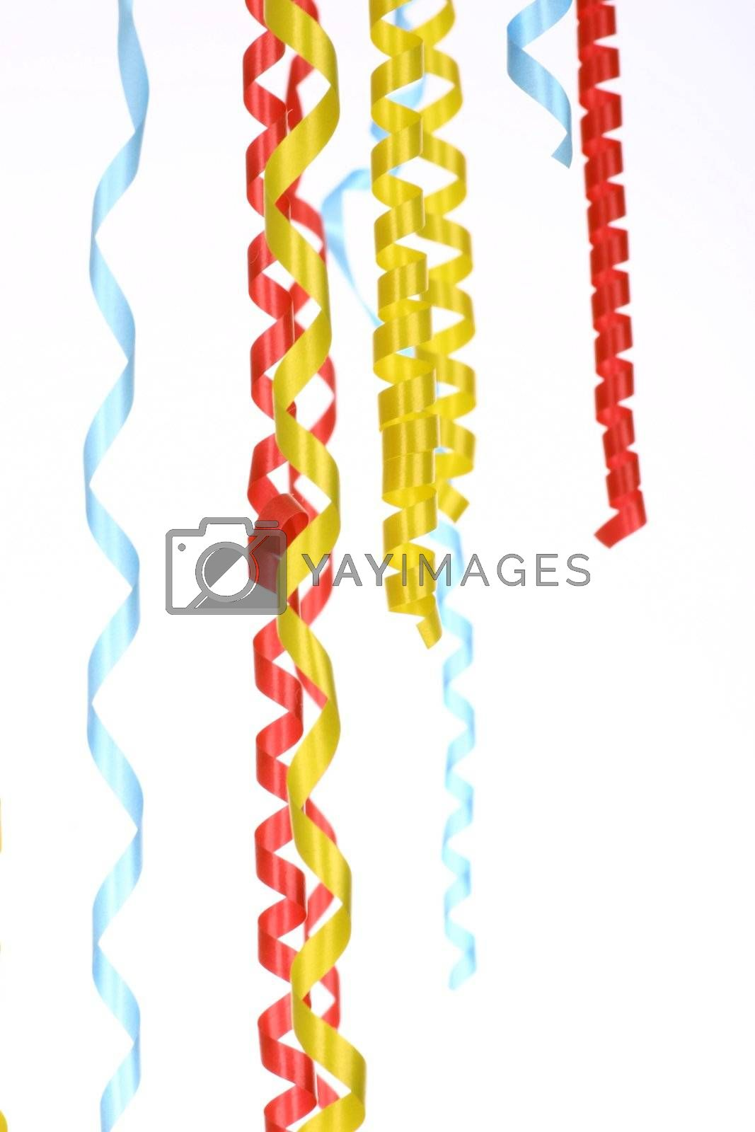 Celebratory streamer of red green and yellow color on a white background (look similar images in my portfolio)