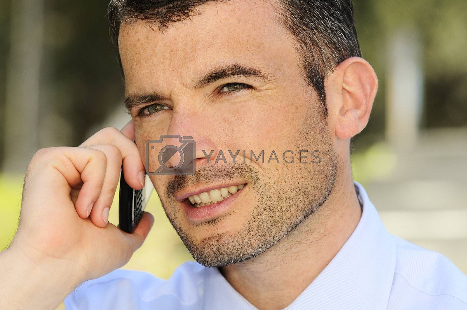 businessman is having a communication with his cellphone