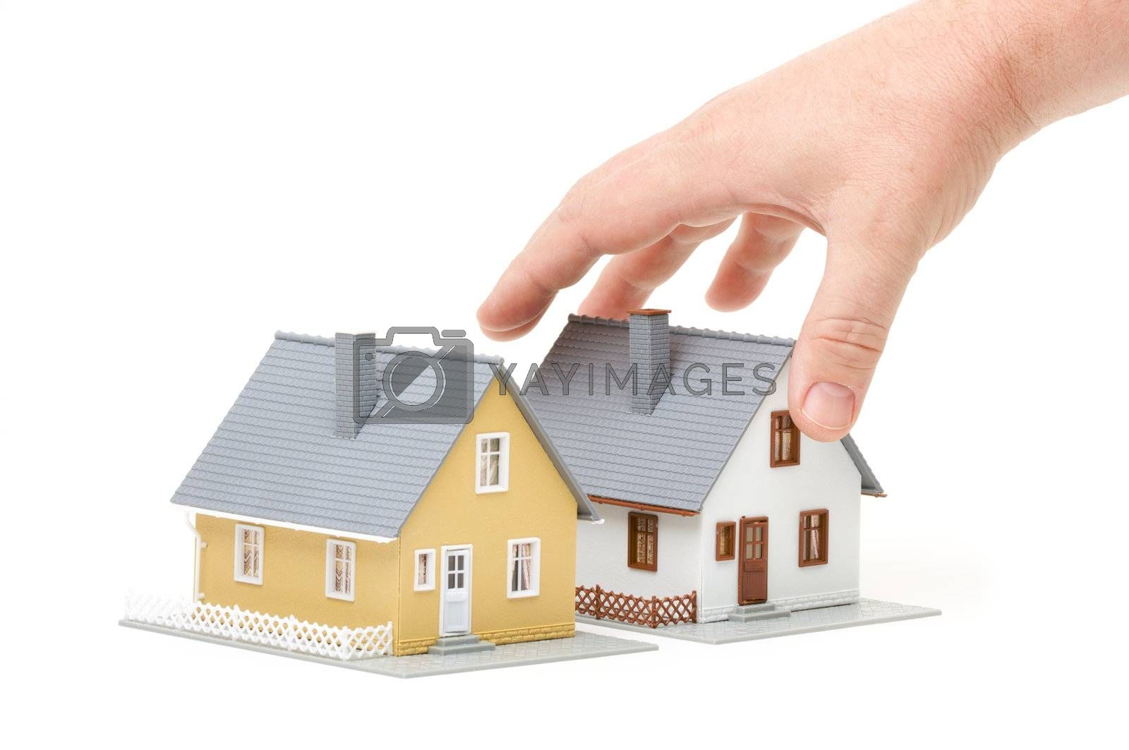Male hand reaching for house isolated on a white background.