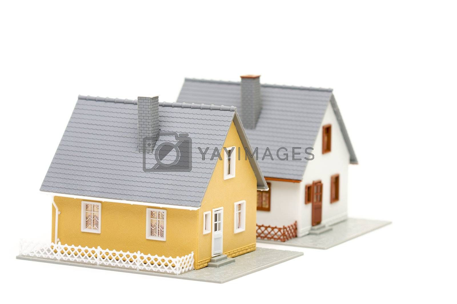 Pair of small houses isolated on a white background.