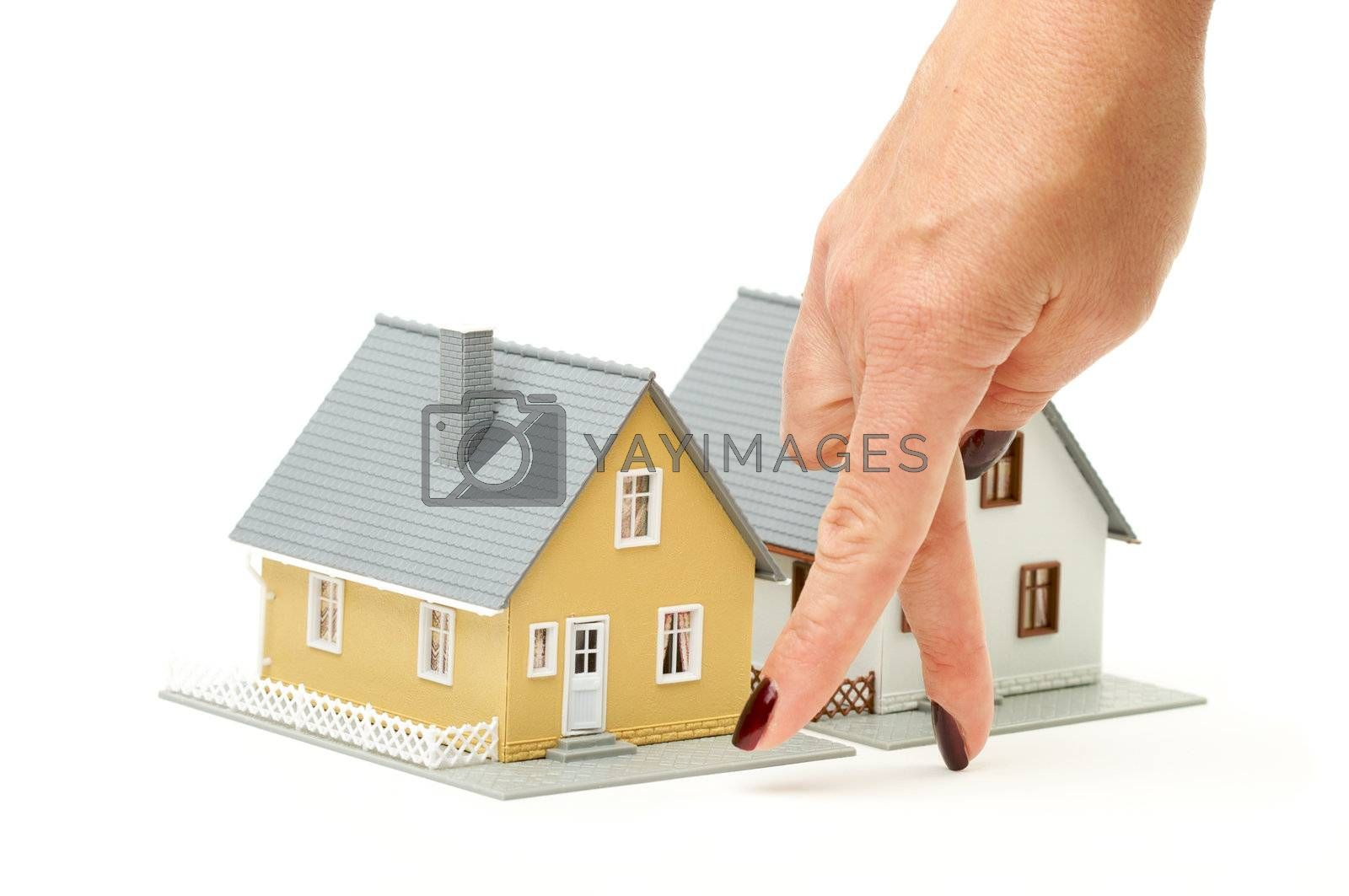 Female hand gesturing house shopping isolated on a white  background.