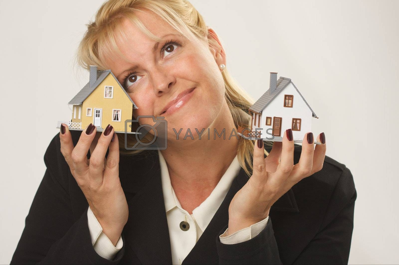 Female dreaming while holding two houses.