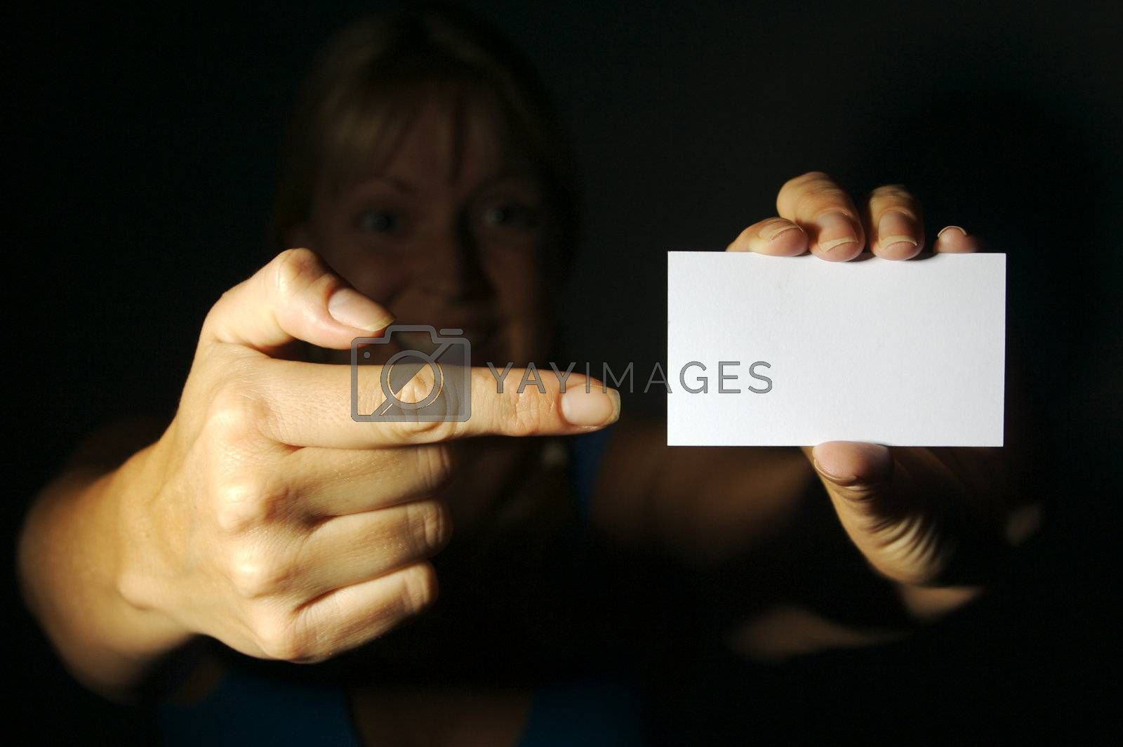 Abstract of Woman Holding Blank Business Card. Room for text and your own message.