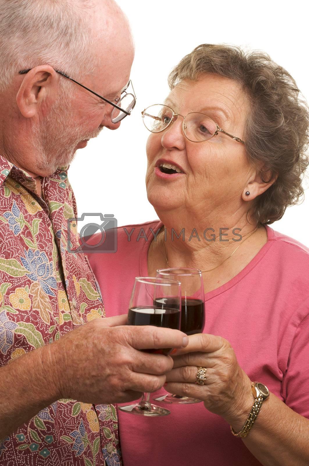 Happy Senior Couple toasting with Winee glasses.