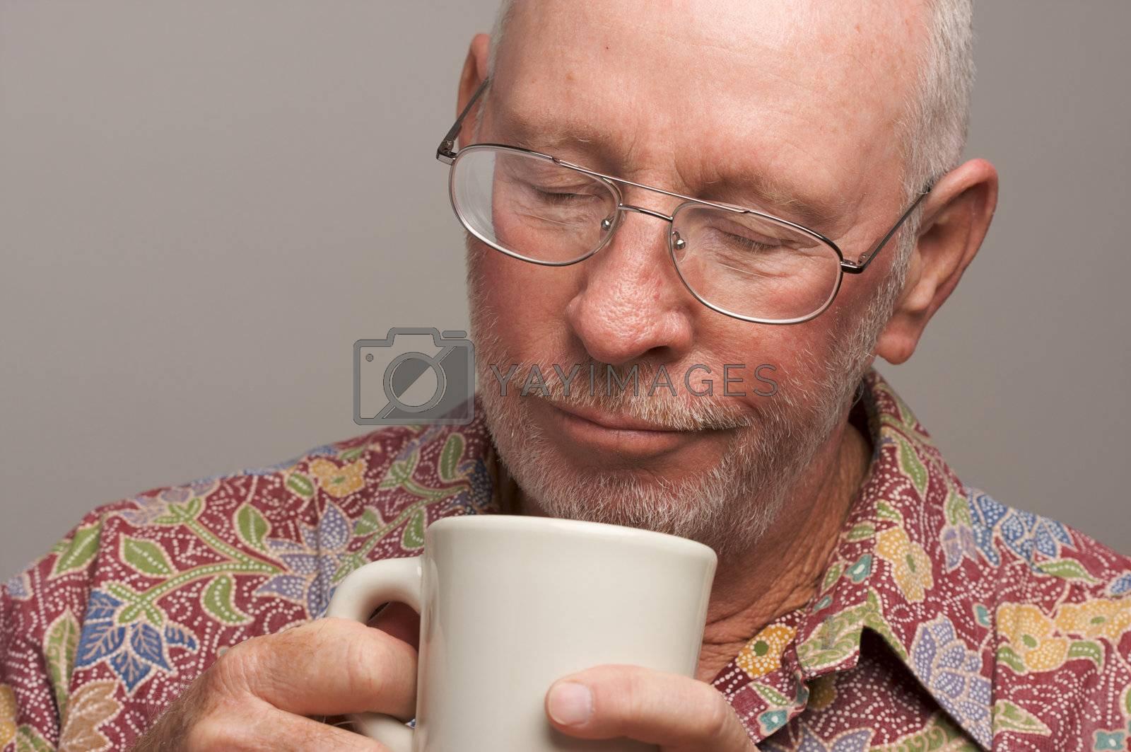 Senior Man Enjoys a Cup of Coffee