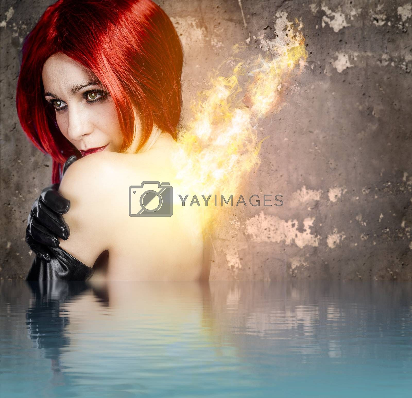 Red-haired woman with back fire on water effect