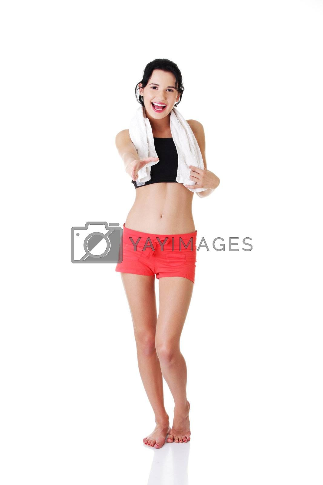 Attractive fitness woman in sport clothes ready for handshake.