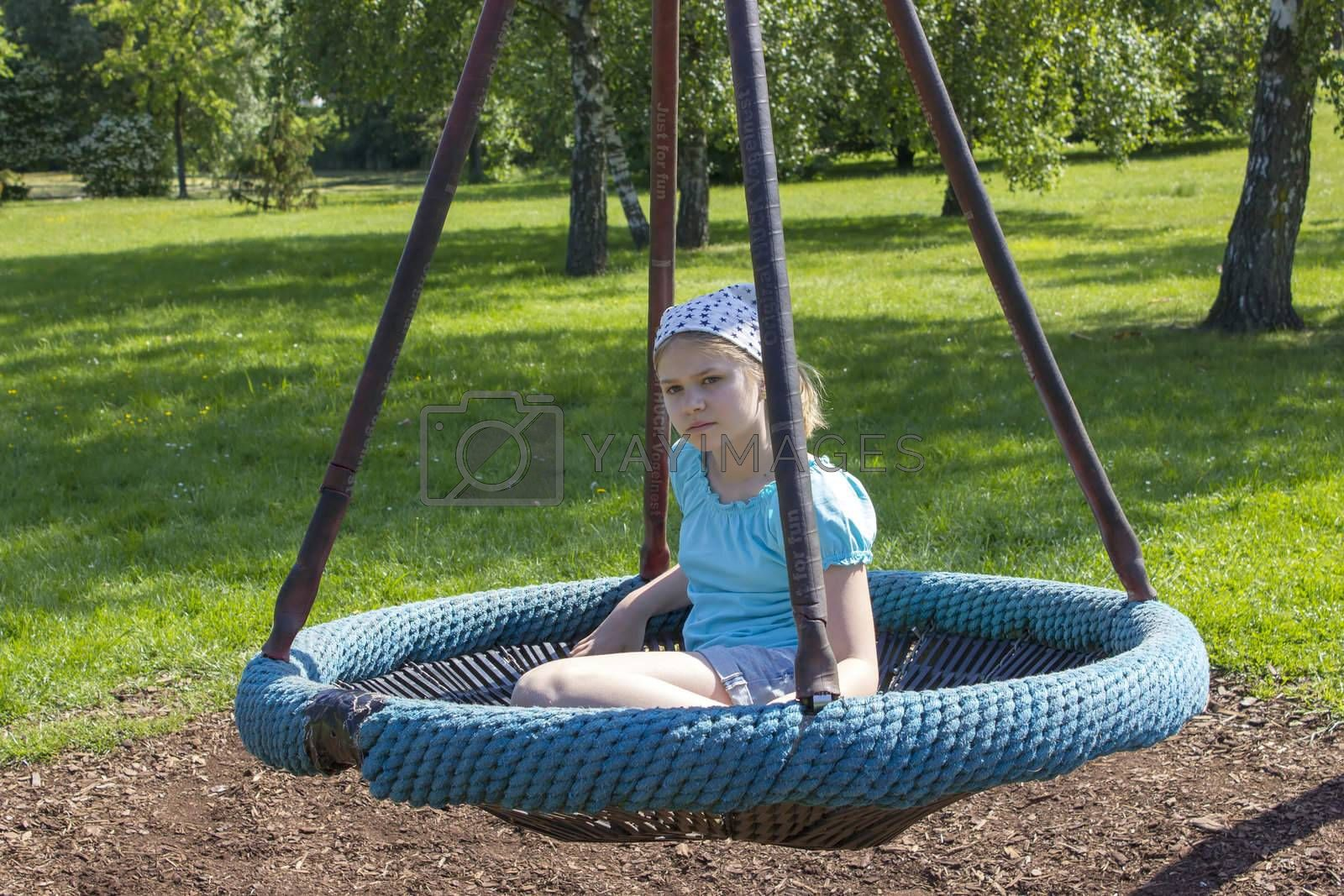Young girl on swing in the park