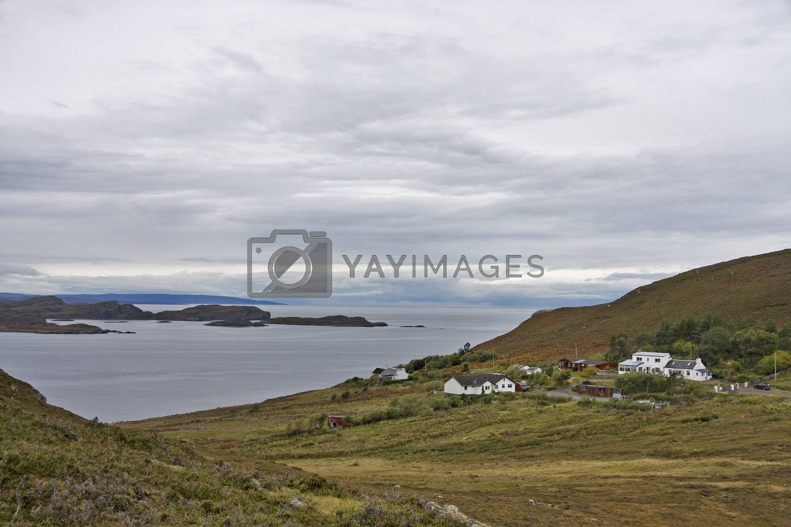 remote estate at coastline in scotland with wetland in front