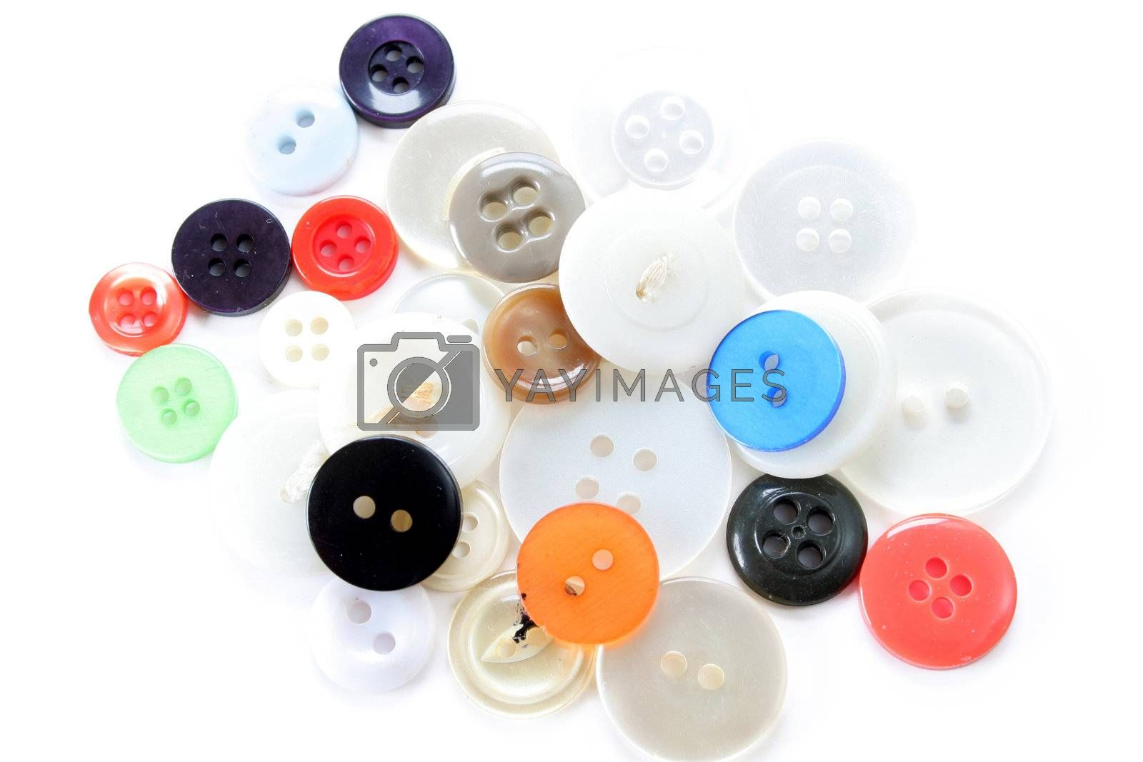 Mixture of buttons isolated on a white background.