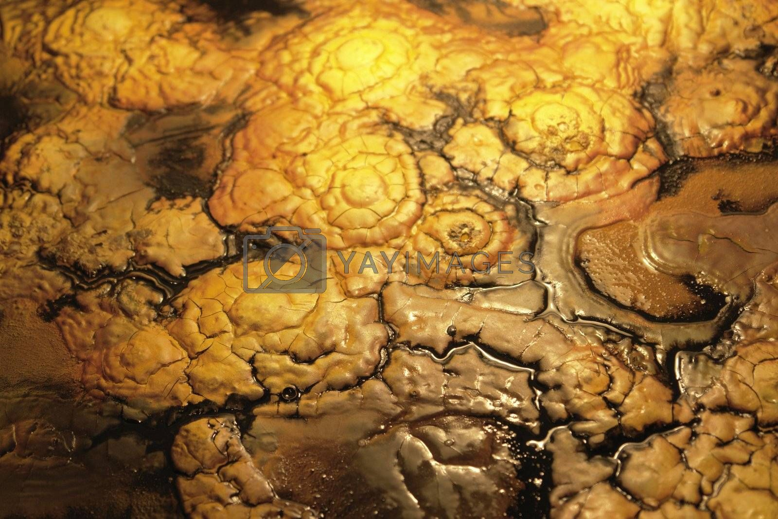 abstract full frame background showing wet paint detail with pastose brown and yellow colors