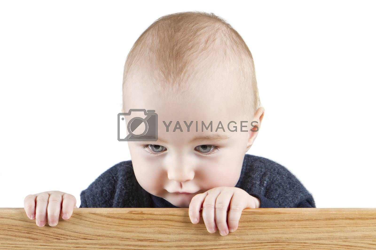 young child holding wooden board. isolate on white background