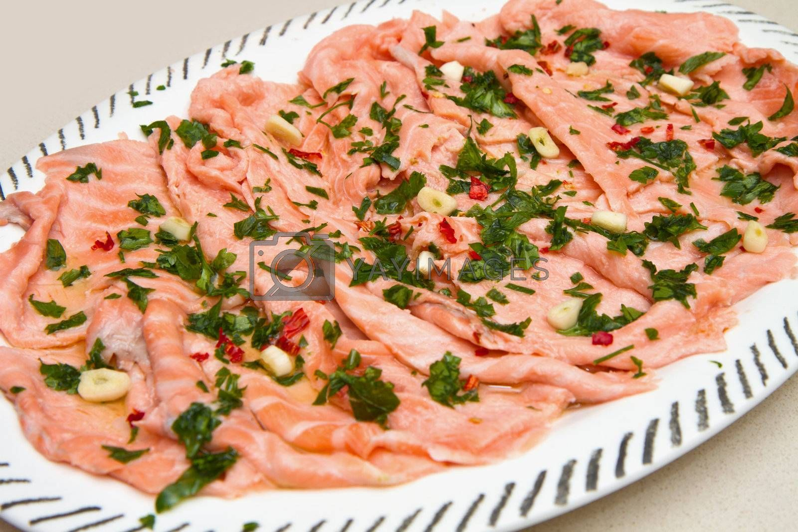 dish with marinated salmon