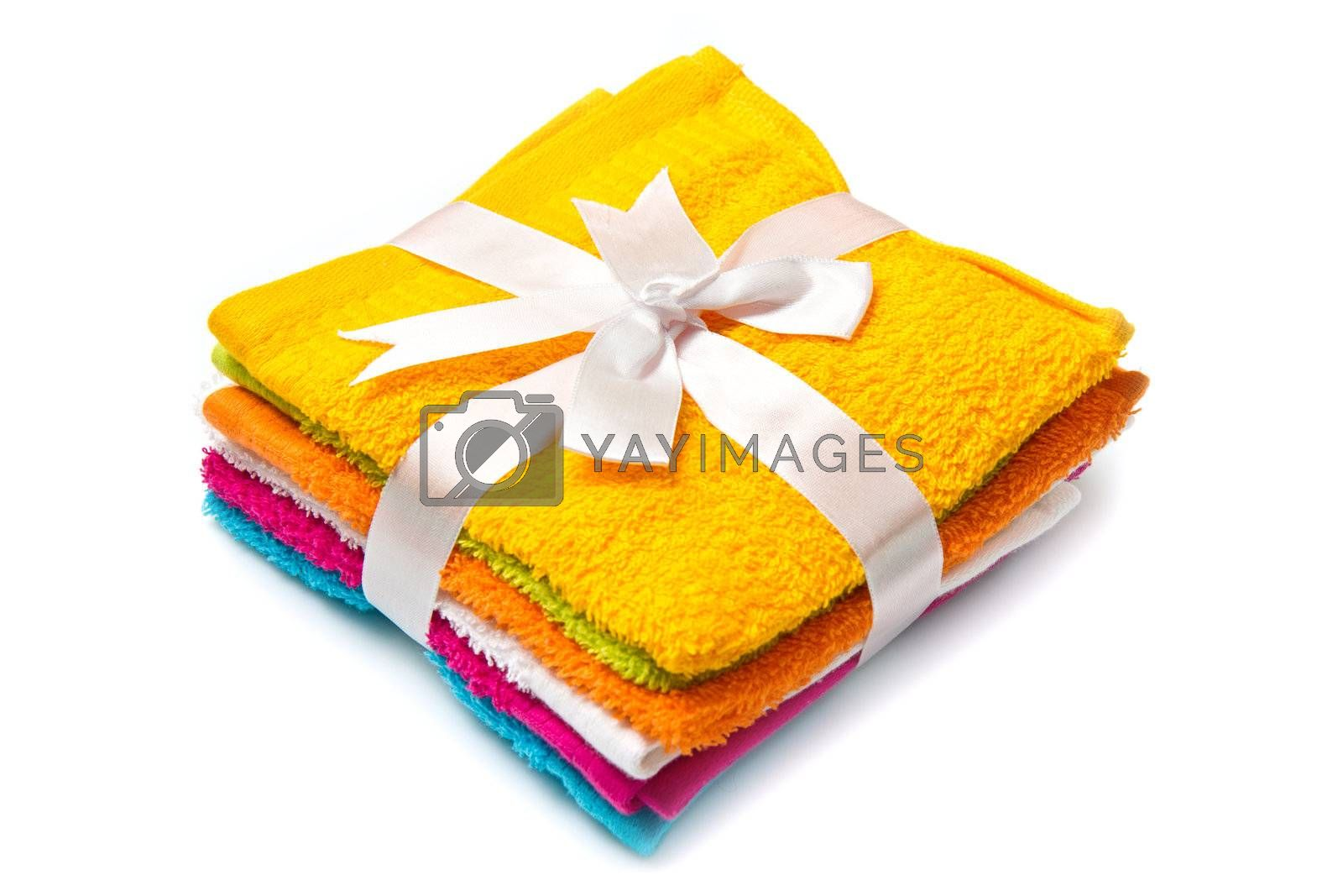 a group of colored towels on white background