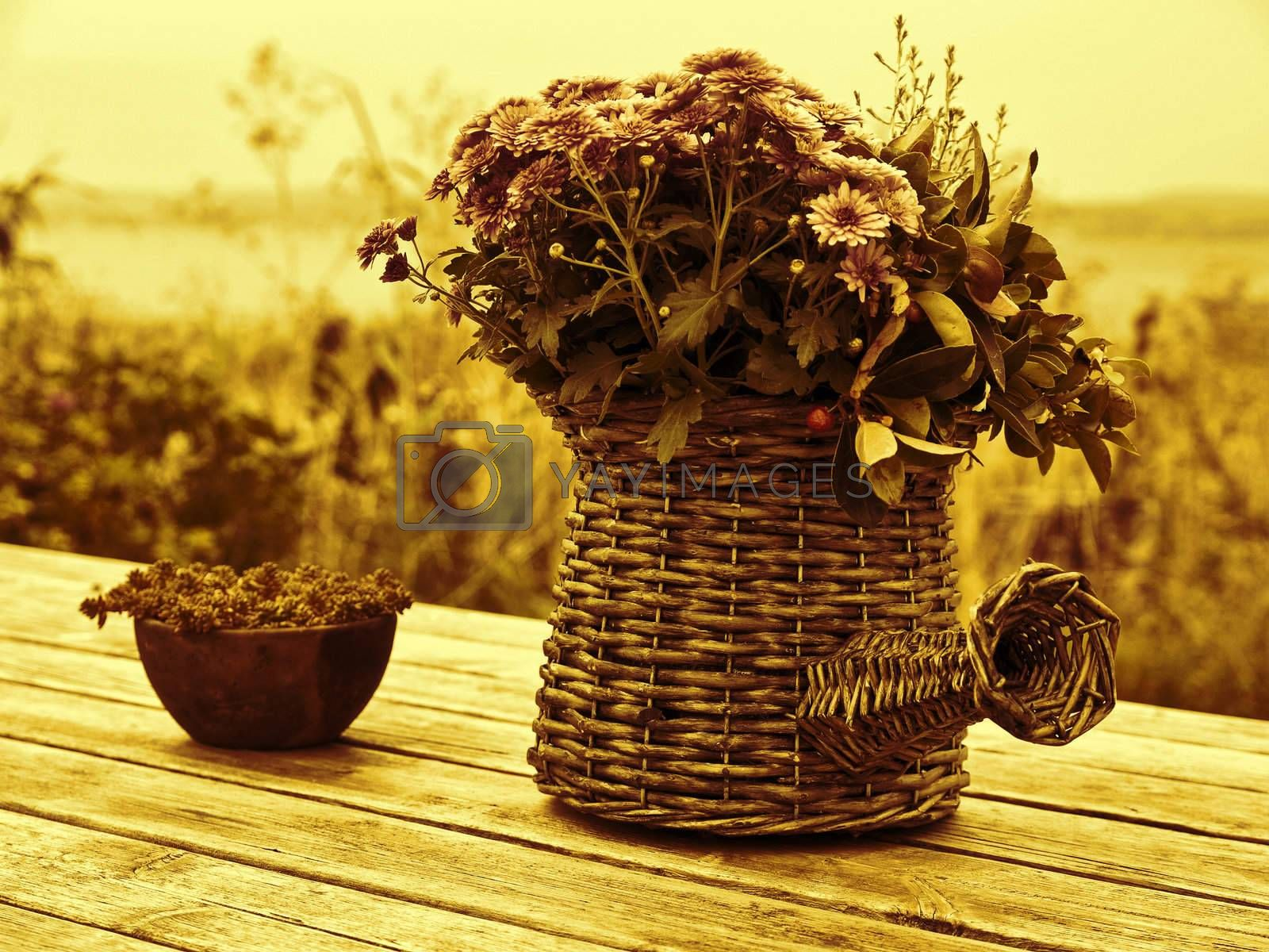 Beautiful still life basket of flowers on a wooden table digital art manipulated
