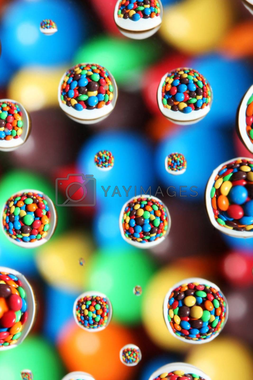 abstract background,colorful candies reflected in water drops