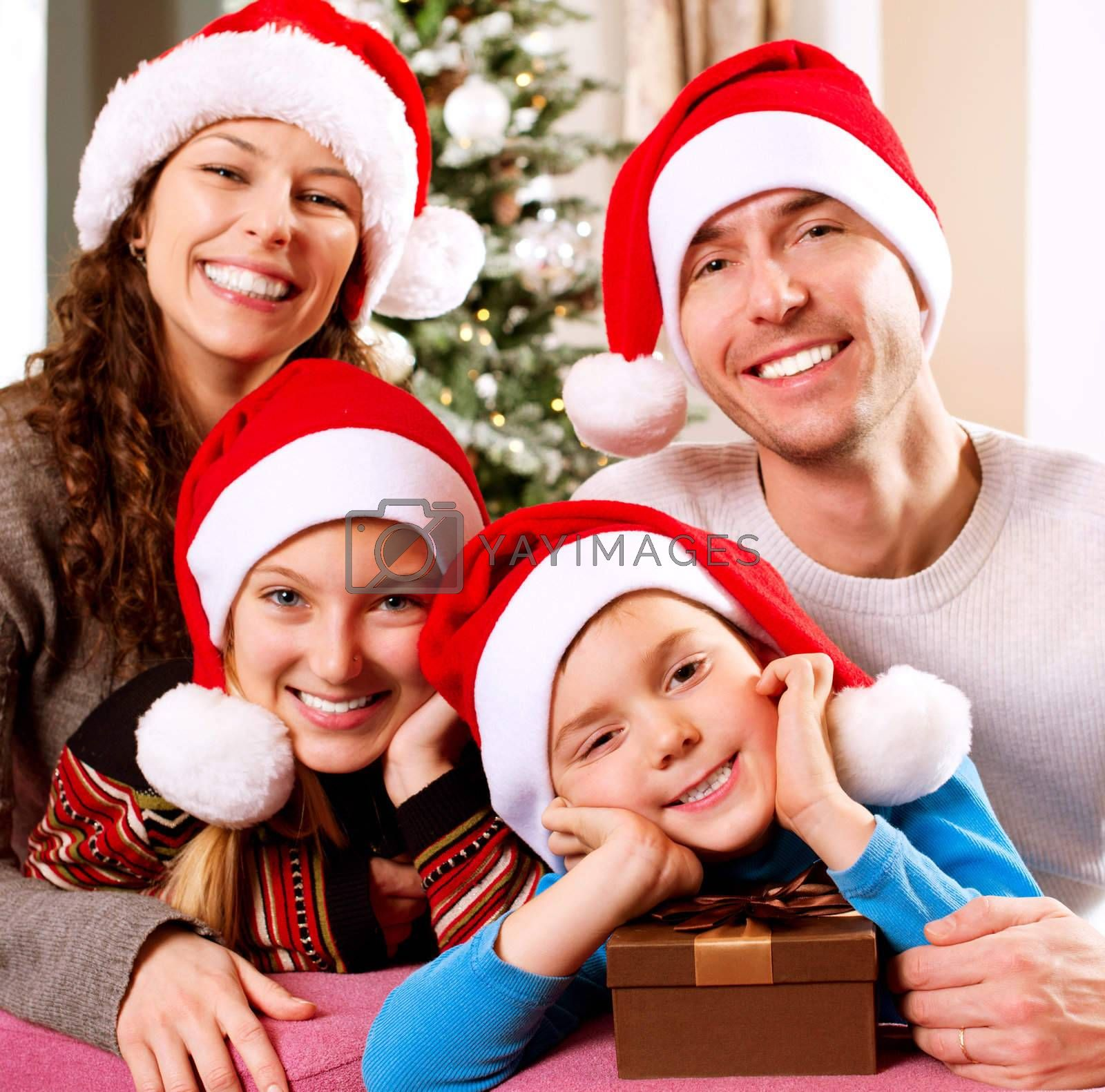 Christmas Family with Kids. Happy Smiling Parents and Children  by SubbotinaA