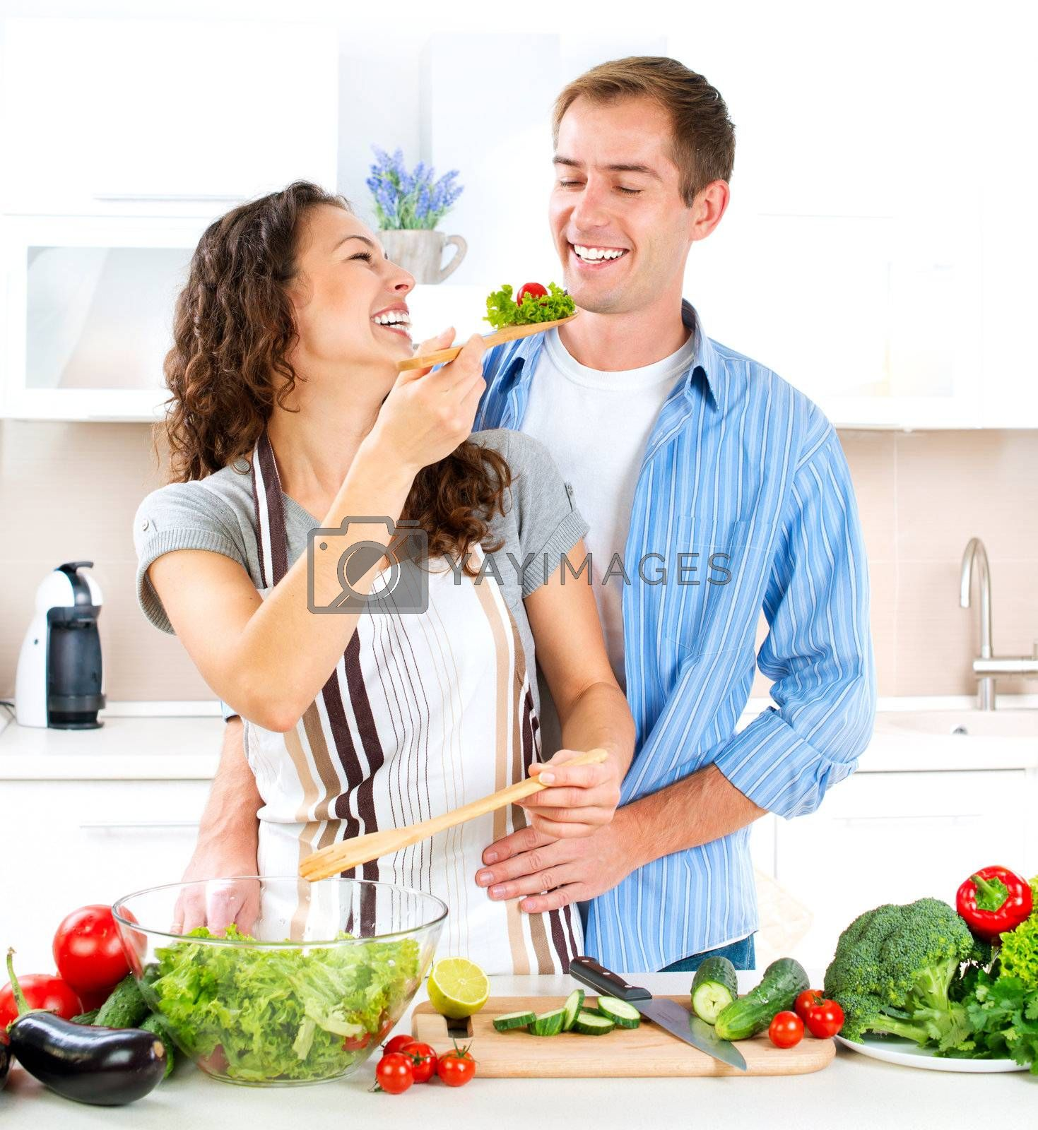 Happy Couple Cooking Together. Dieting. Healthy Food  by Subbotina Anna