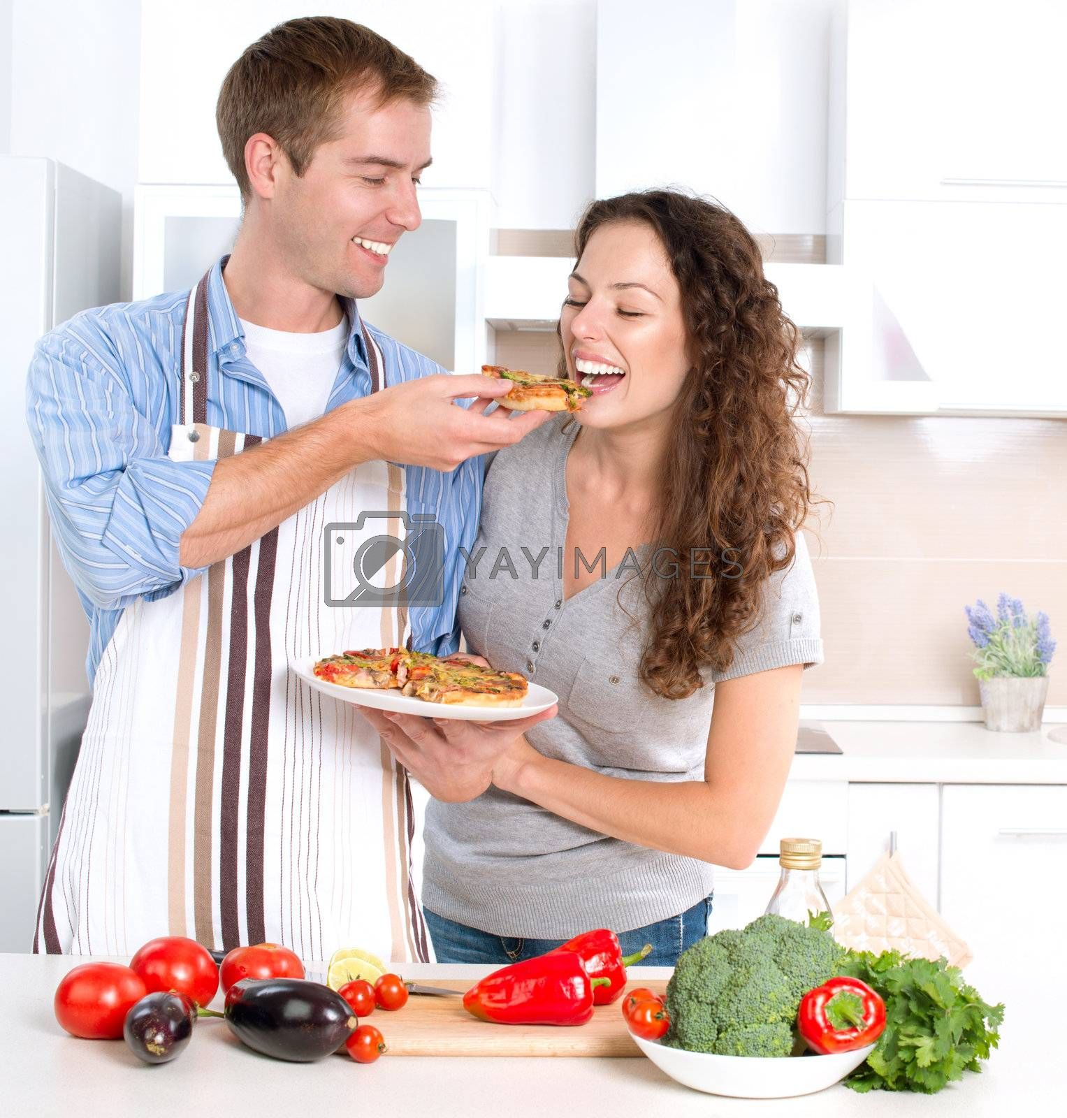 Happy Couple Eating Pizza. Cooking Together  by Subbotina Anna