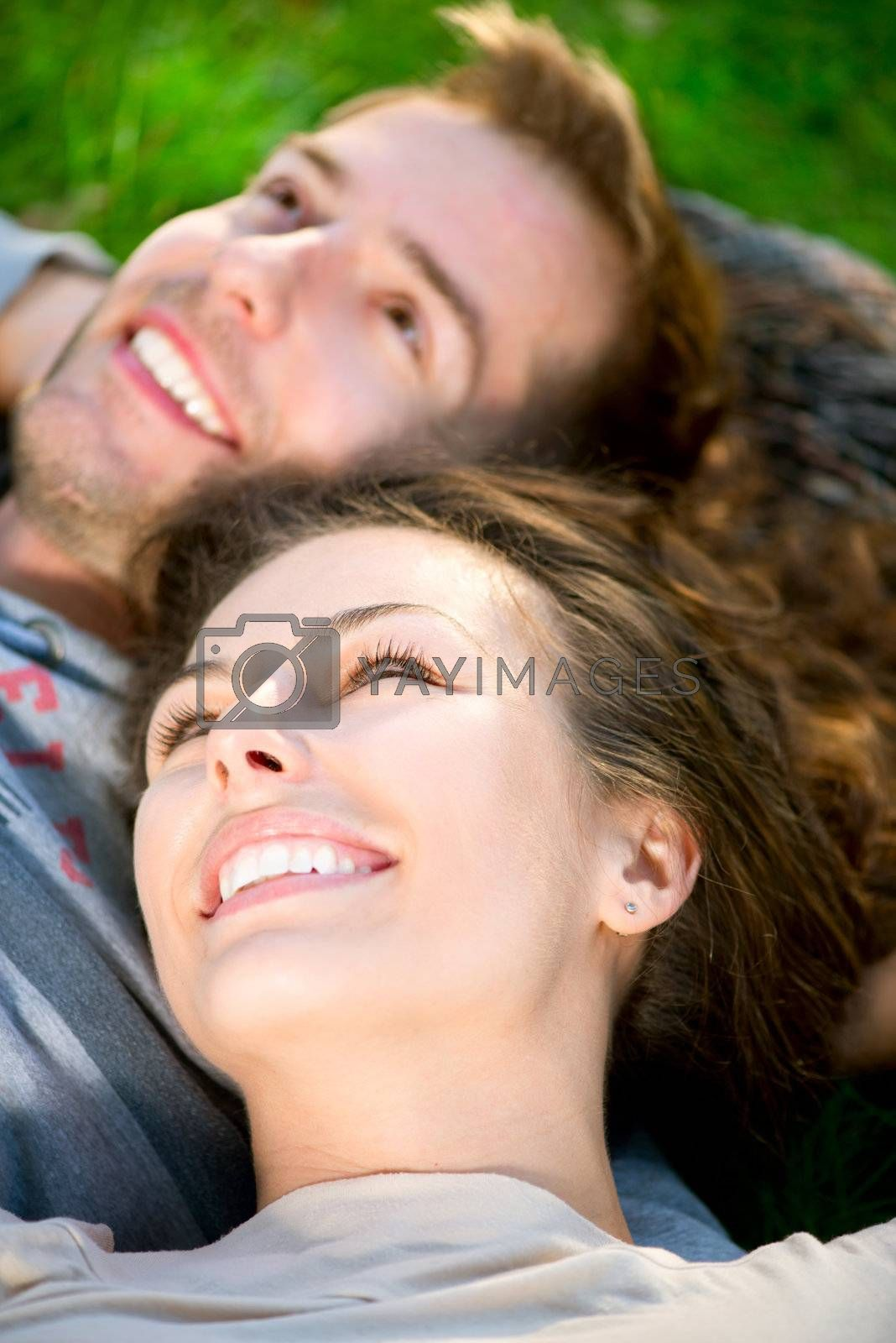 Young Couple Lying on Grass Outdoor by Subbotina Anna