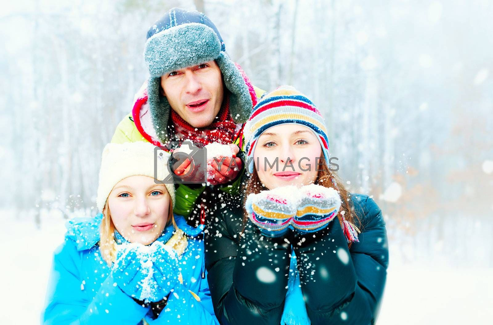 Family Outdoors. Happy Family Blowing Snow  by Subbotina Anna