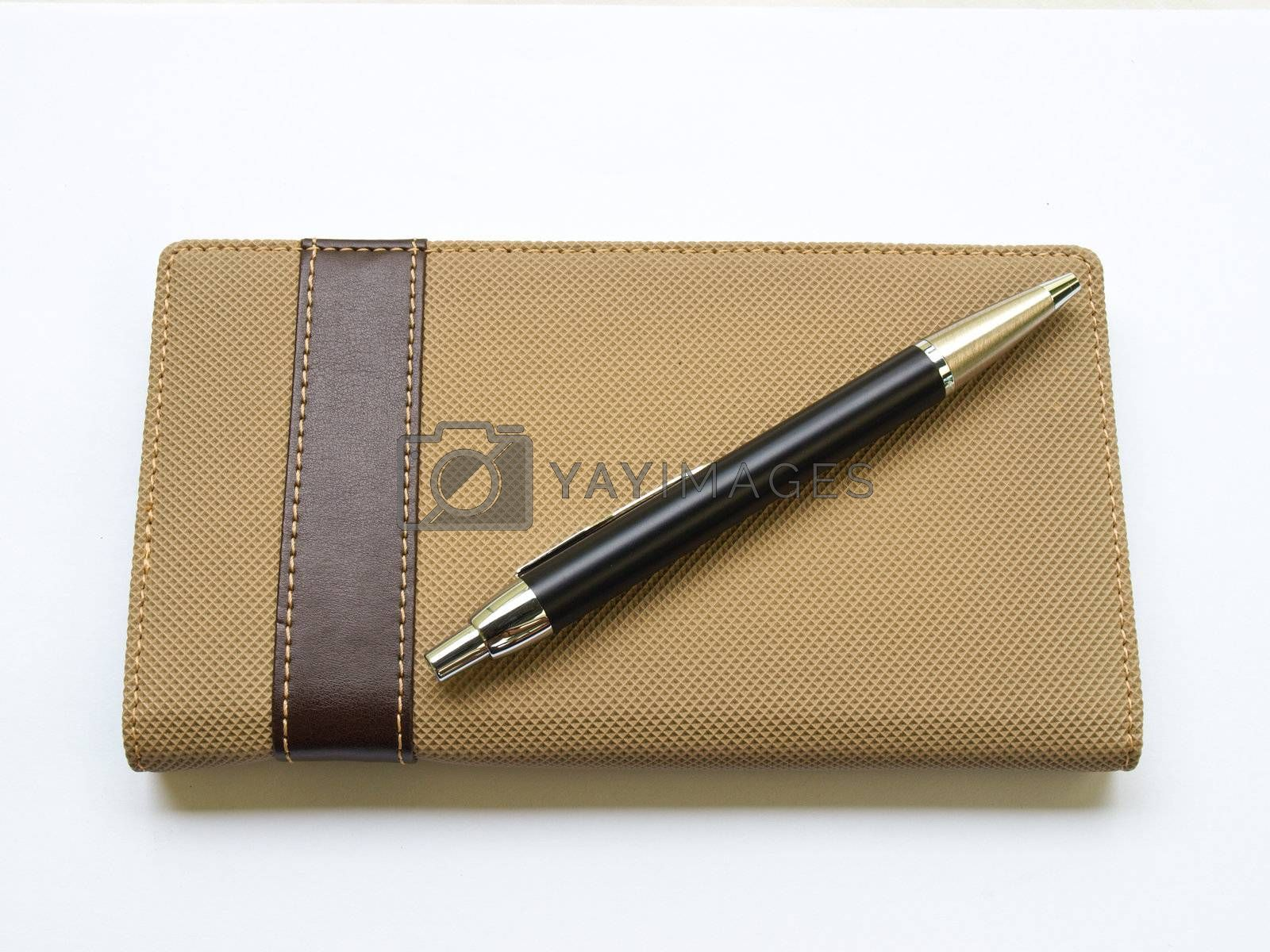 Light brown notebook and pen  cover isolated on white background
