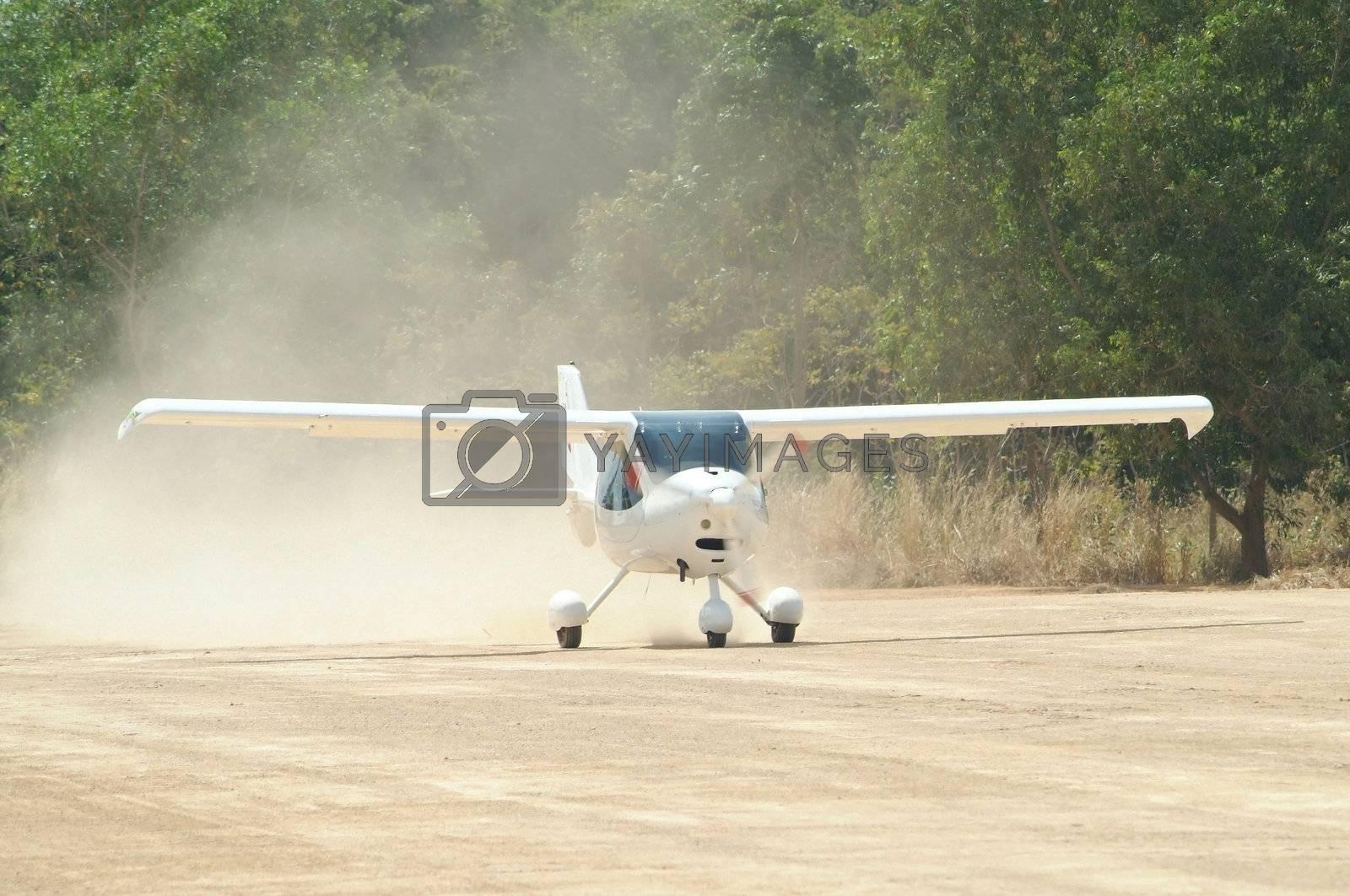 Small, white airplane by epixx