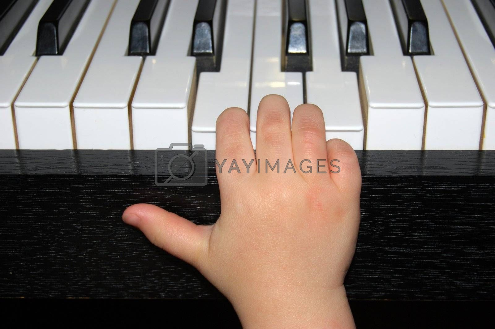 Child training at the piano