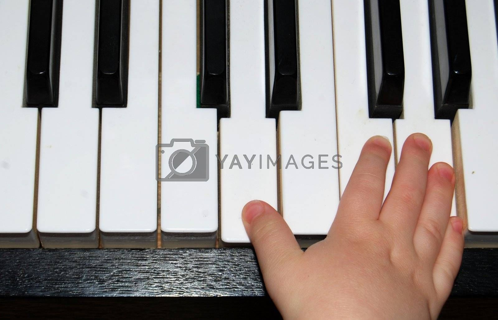 Child practising the piano