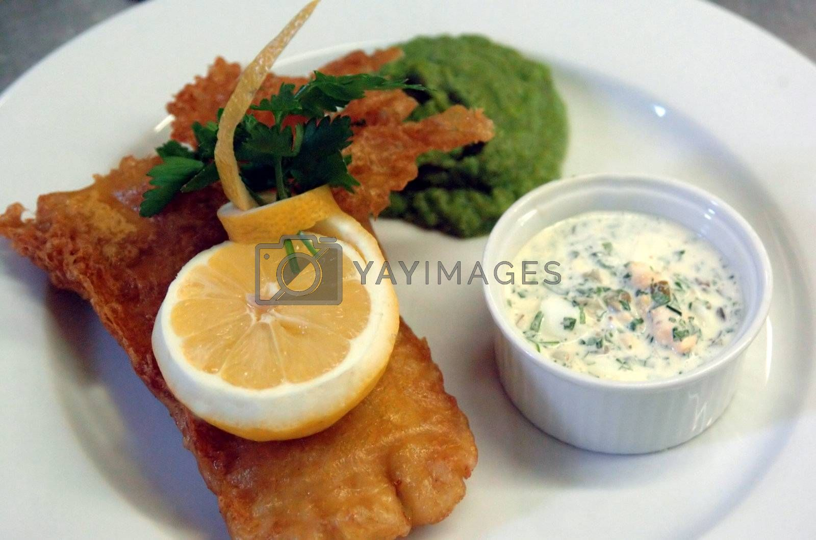 Fish `n Chips is the english british dish par excellence here with sauce gribiche in a ramekin