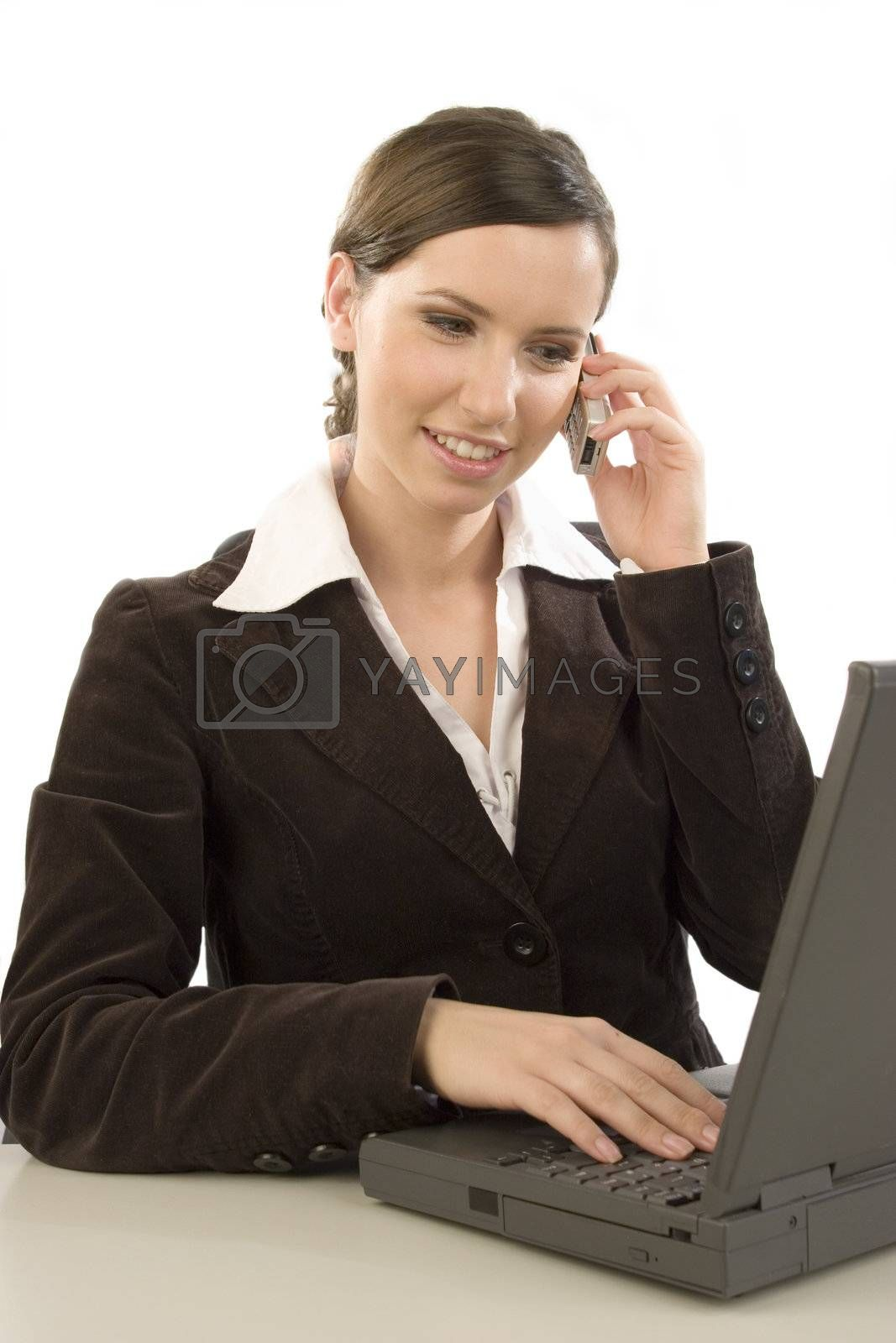 Young attractive woman working with laptop and cell phone