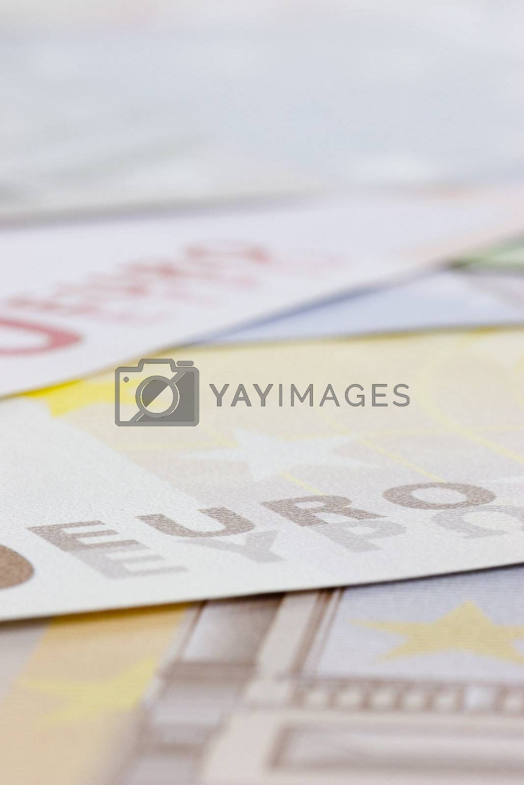 Euro banknotes with shallow depth of field - focus on the word EURO
