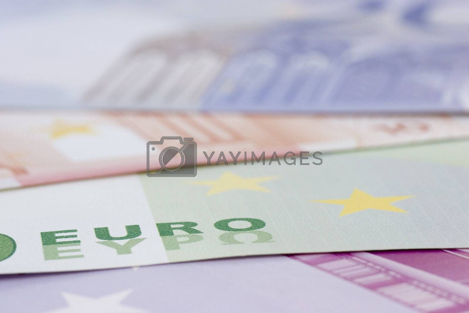 Close-up of euro banknotes with focus on the word euro