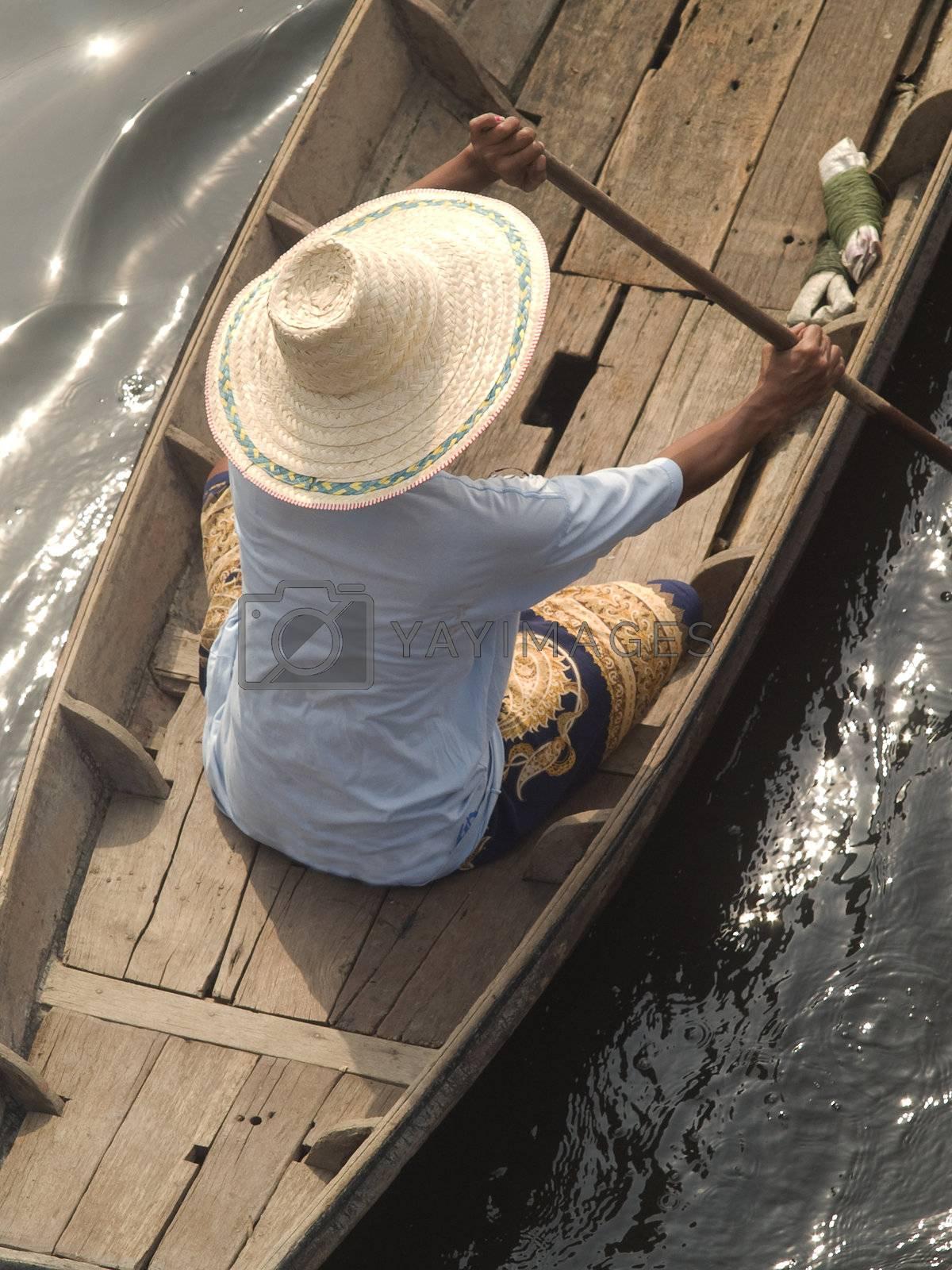 Asian woman in boat by epixx