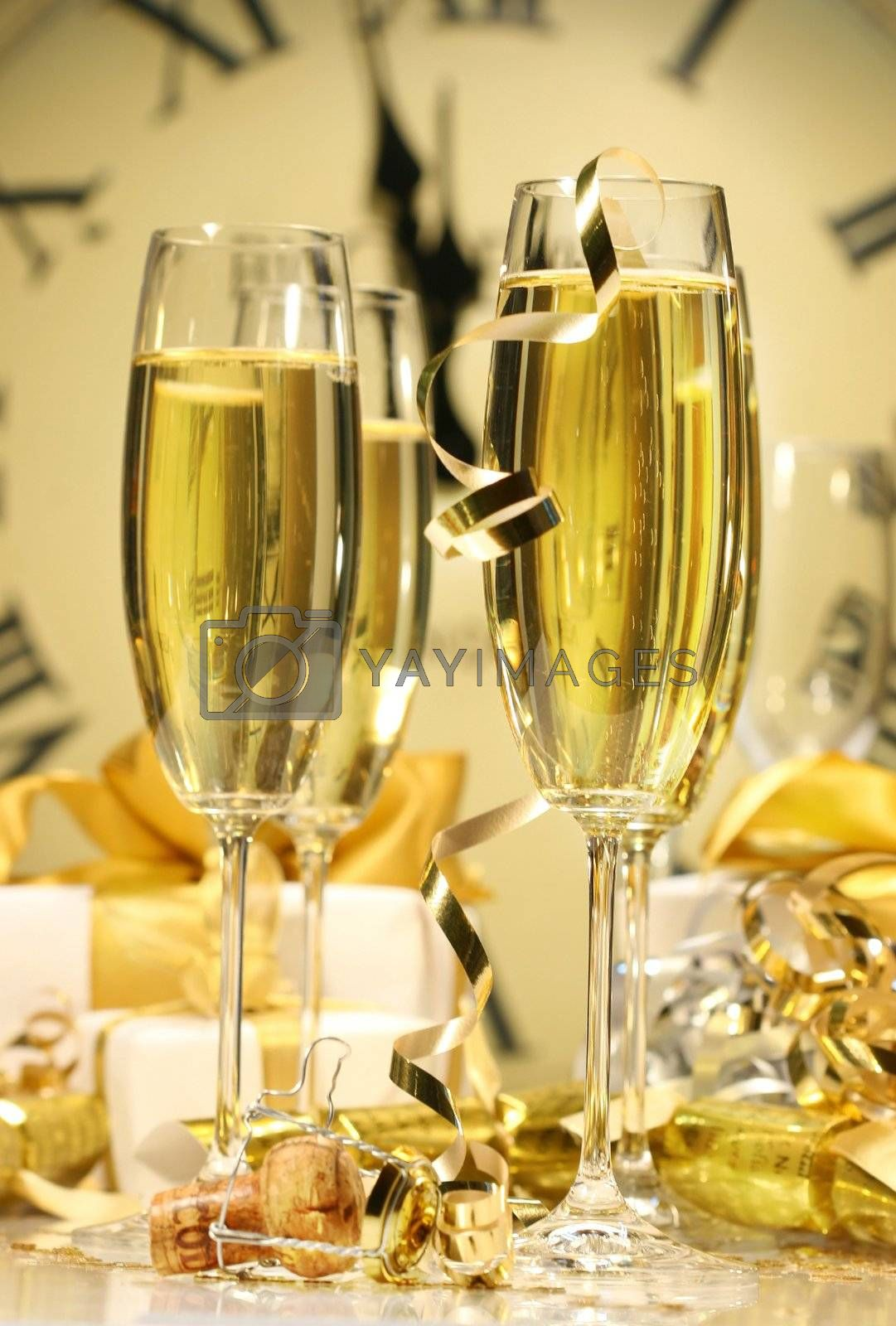 Glasses of champagne ready to celebrate by Sandralise