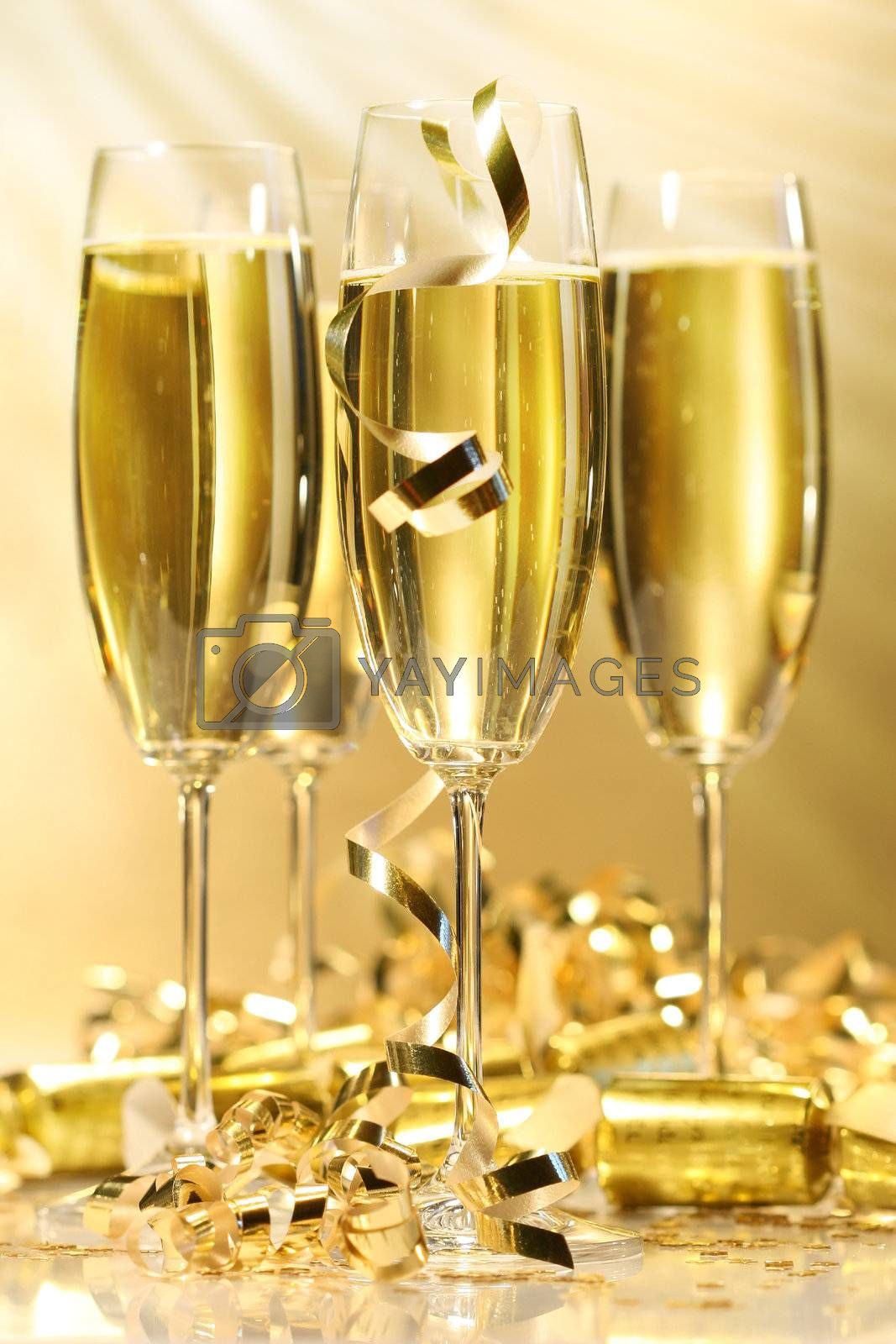 Glasses of golden champagne by Sandralise