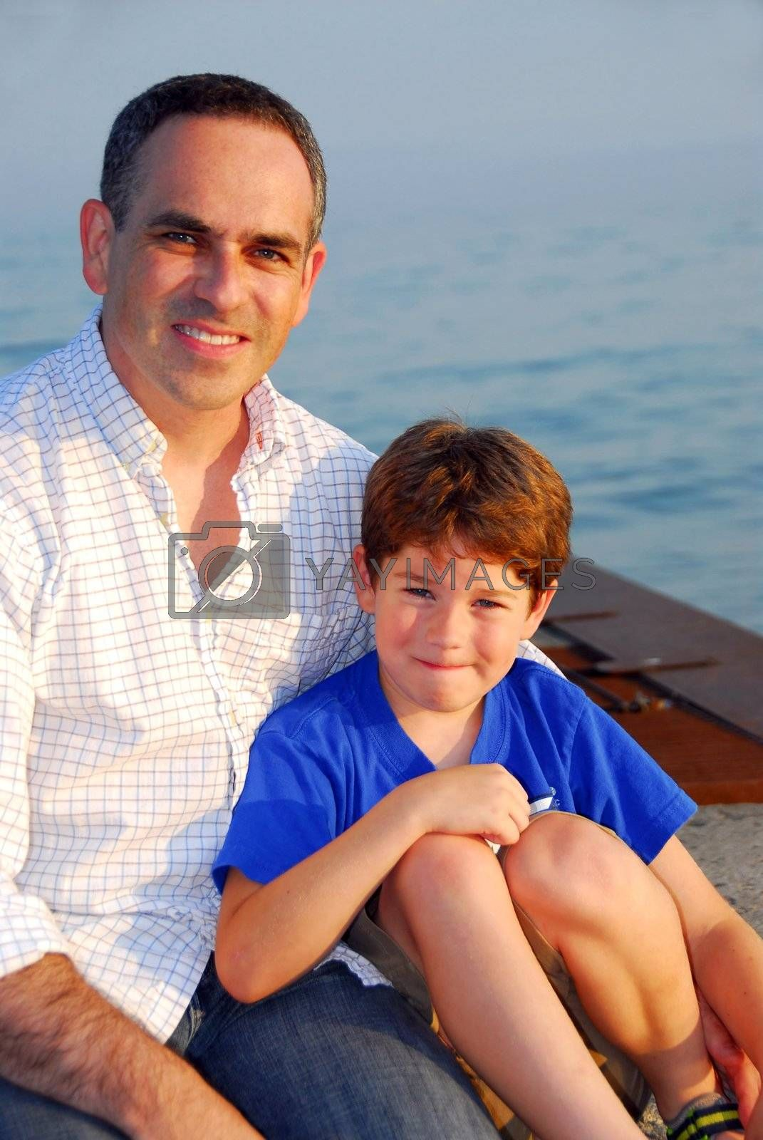 Portrait of a father and son on a pier
