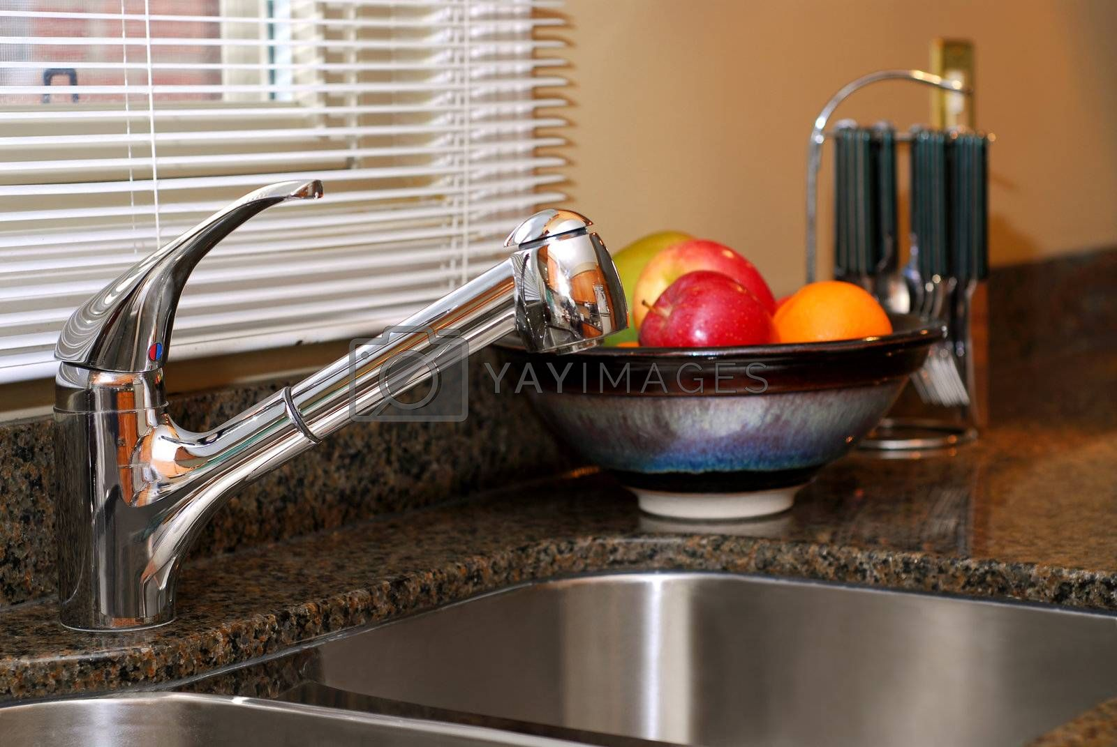 Interior of a modern kitchen with stainless steel double sink