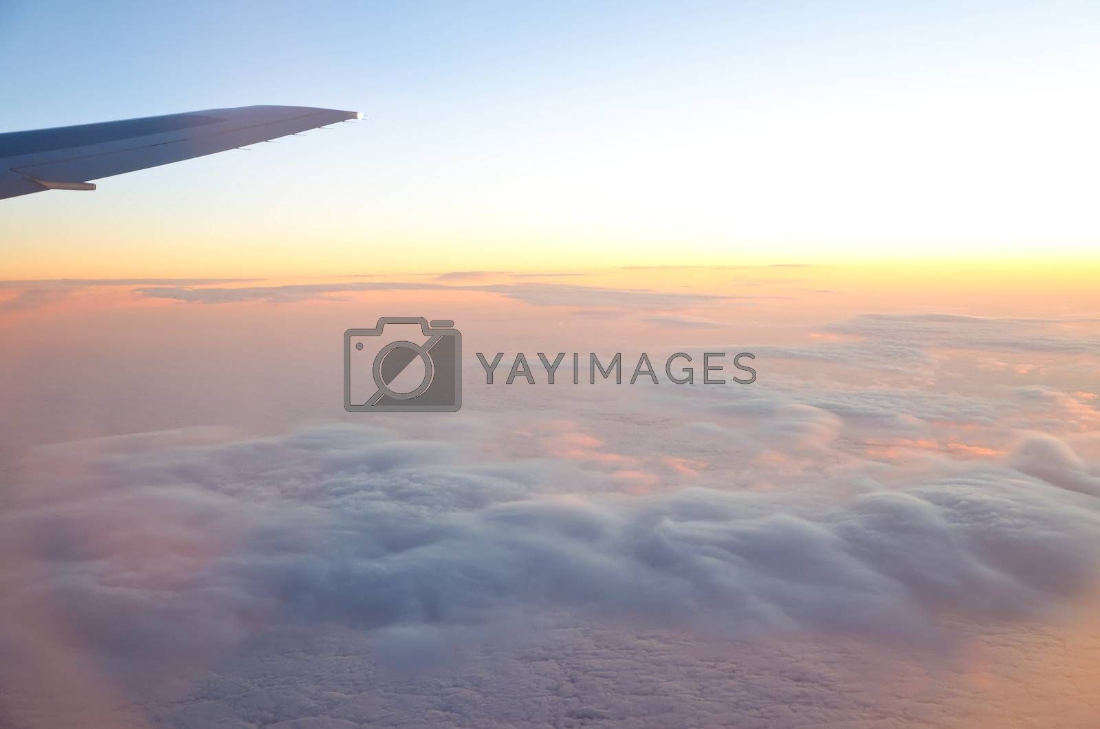 wing of an airplane and low clouds