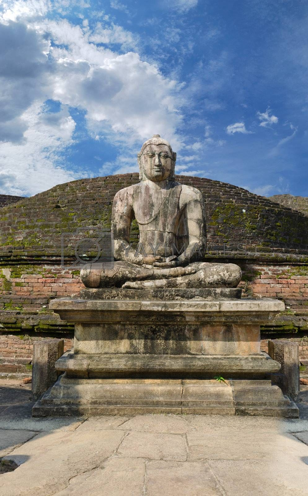 Stone Buddha image on ruins at Polonnaruwa, Sri Lanka