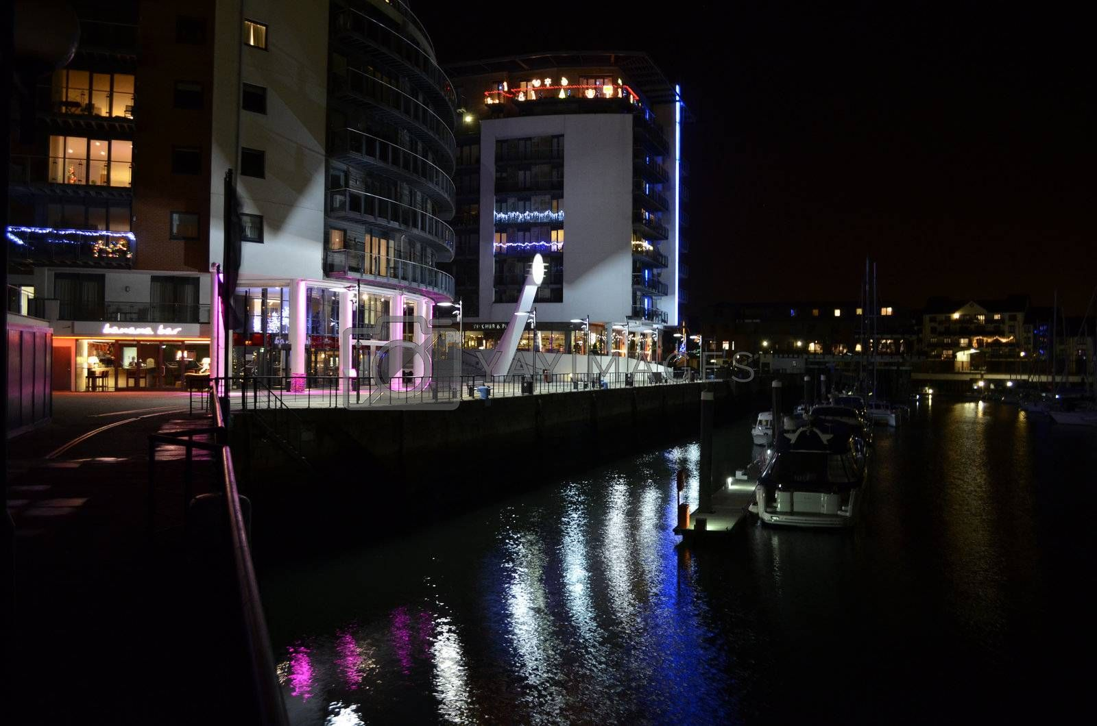 Illuminated evening Marina view with leisure boats and restaurants