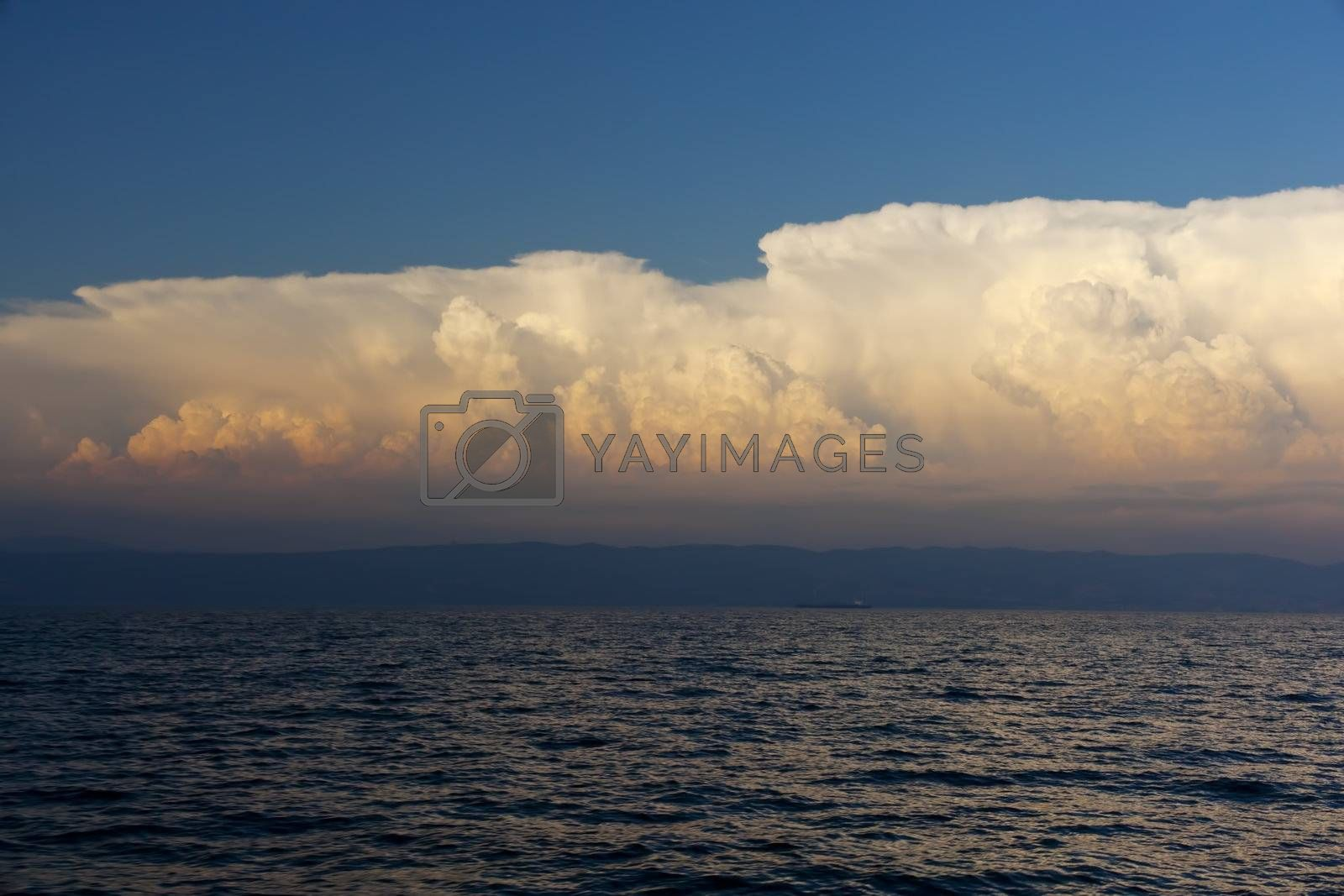 Cloudy sky on the sea at sunset