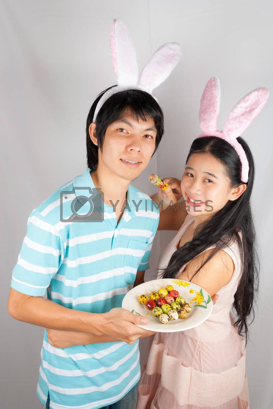 Asian bunny lovers hold Easter eggs  pierced on Ester day.