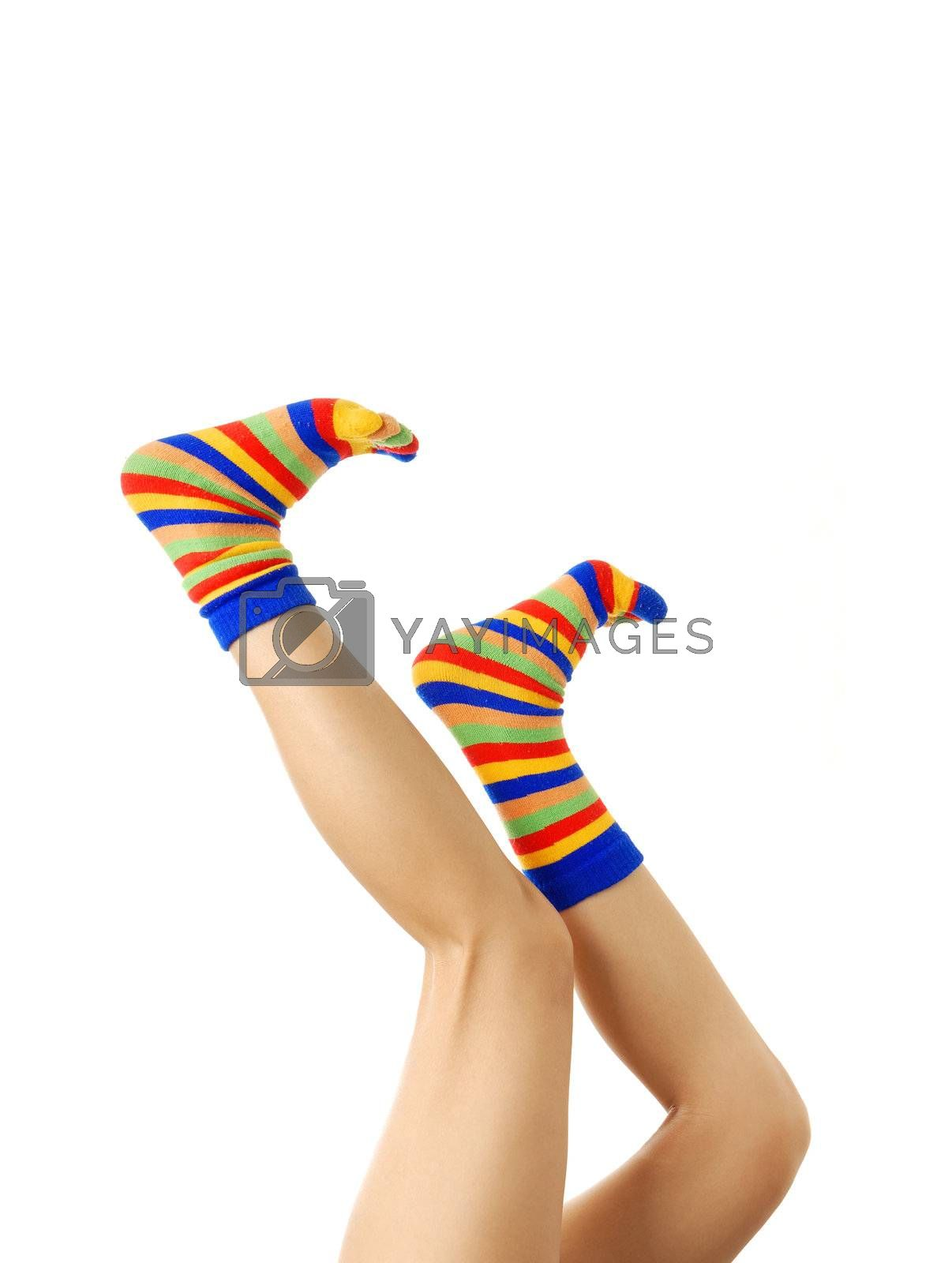 Active woman legs in multi-colored socks