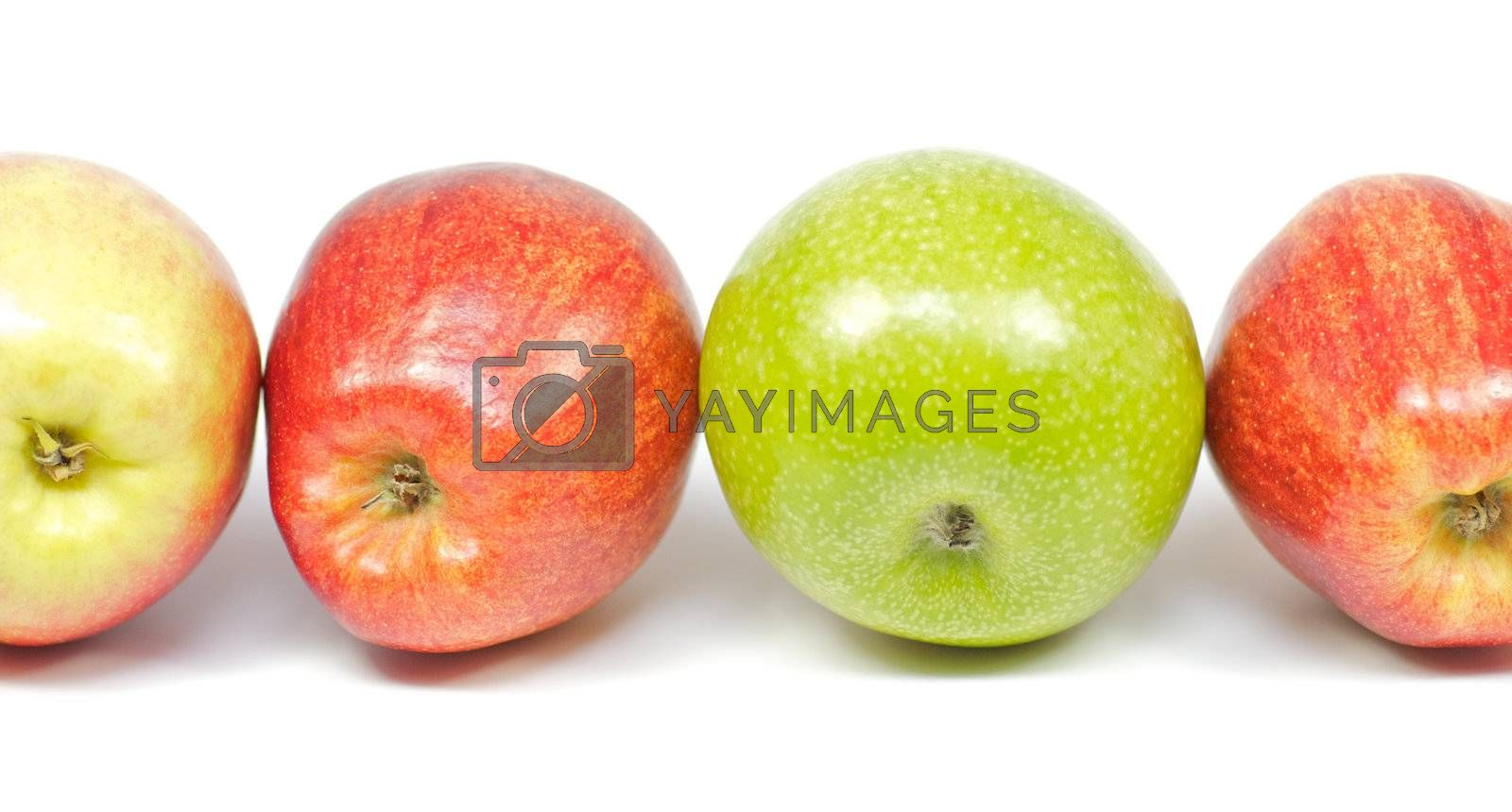 Four delicious apples on white background