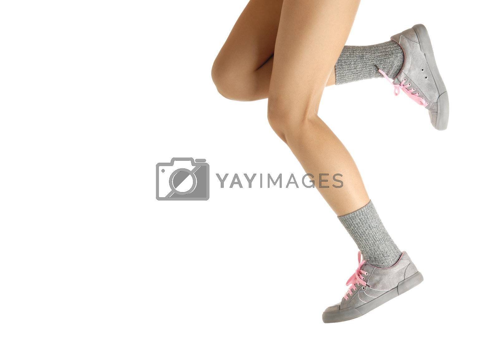 Sport photo of the jumping and running legs in shoes