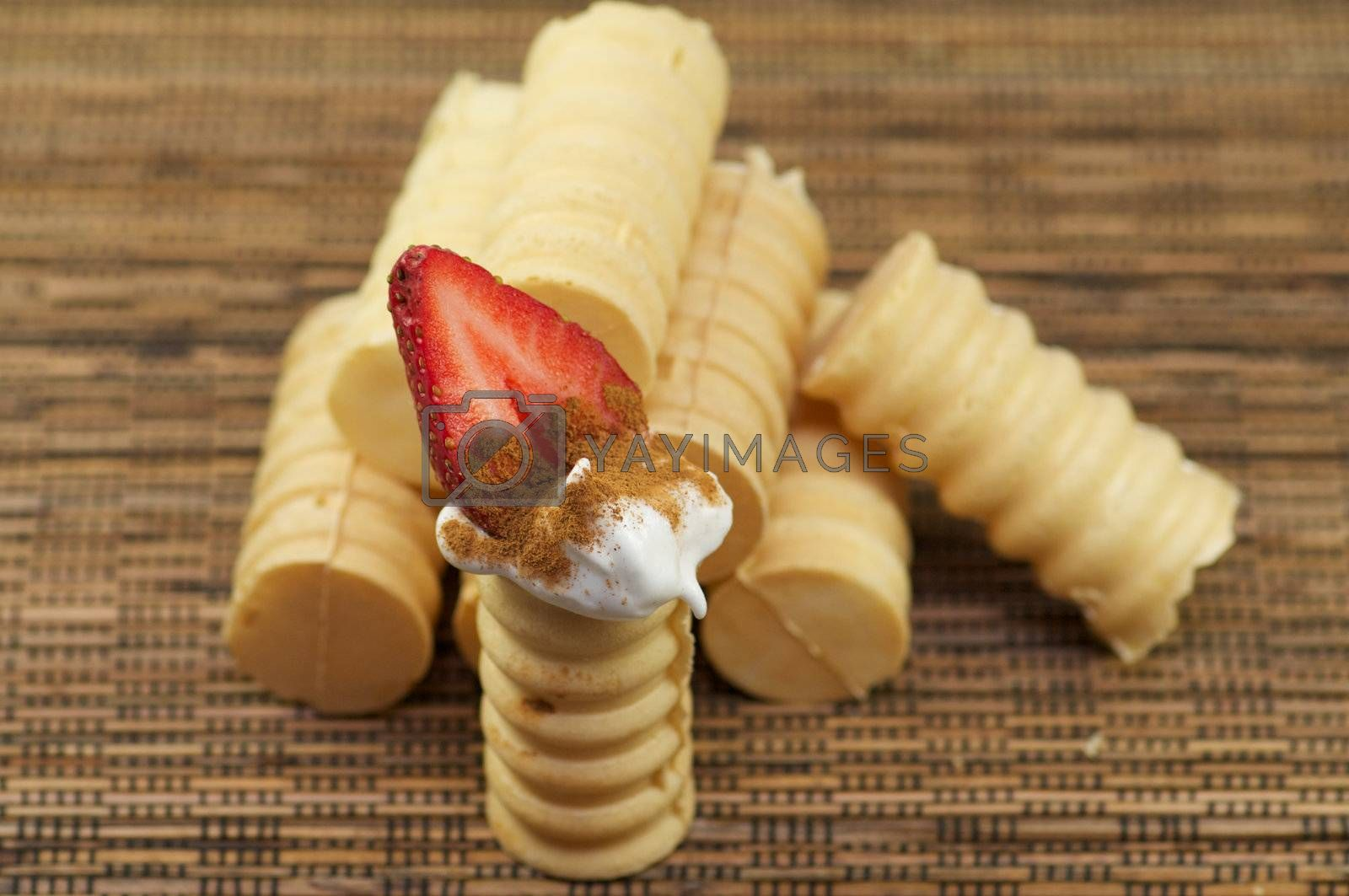 Tubules from shortcake dough with whipped cream and strawberry